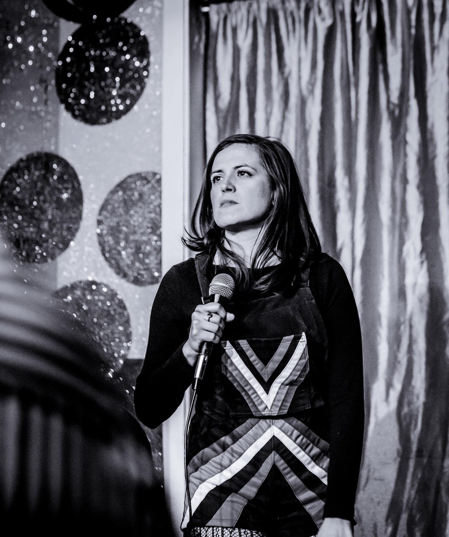 Reflective standup photo by Sarah Larson taken at Tuxedo Cat Comedy in Chicago