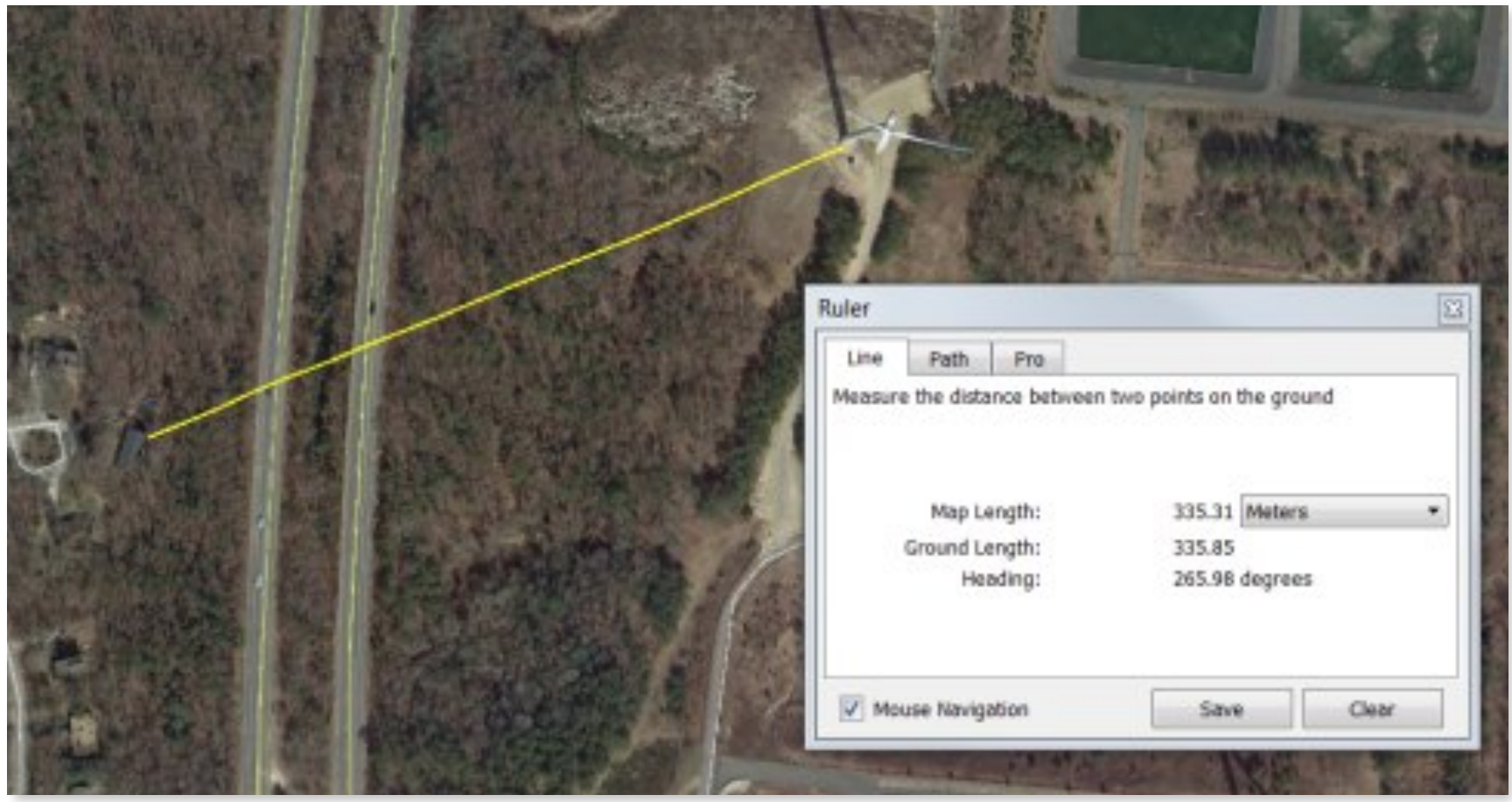 Falmouth turbine showing the closest home located across a divided highway.