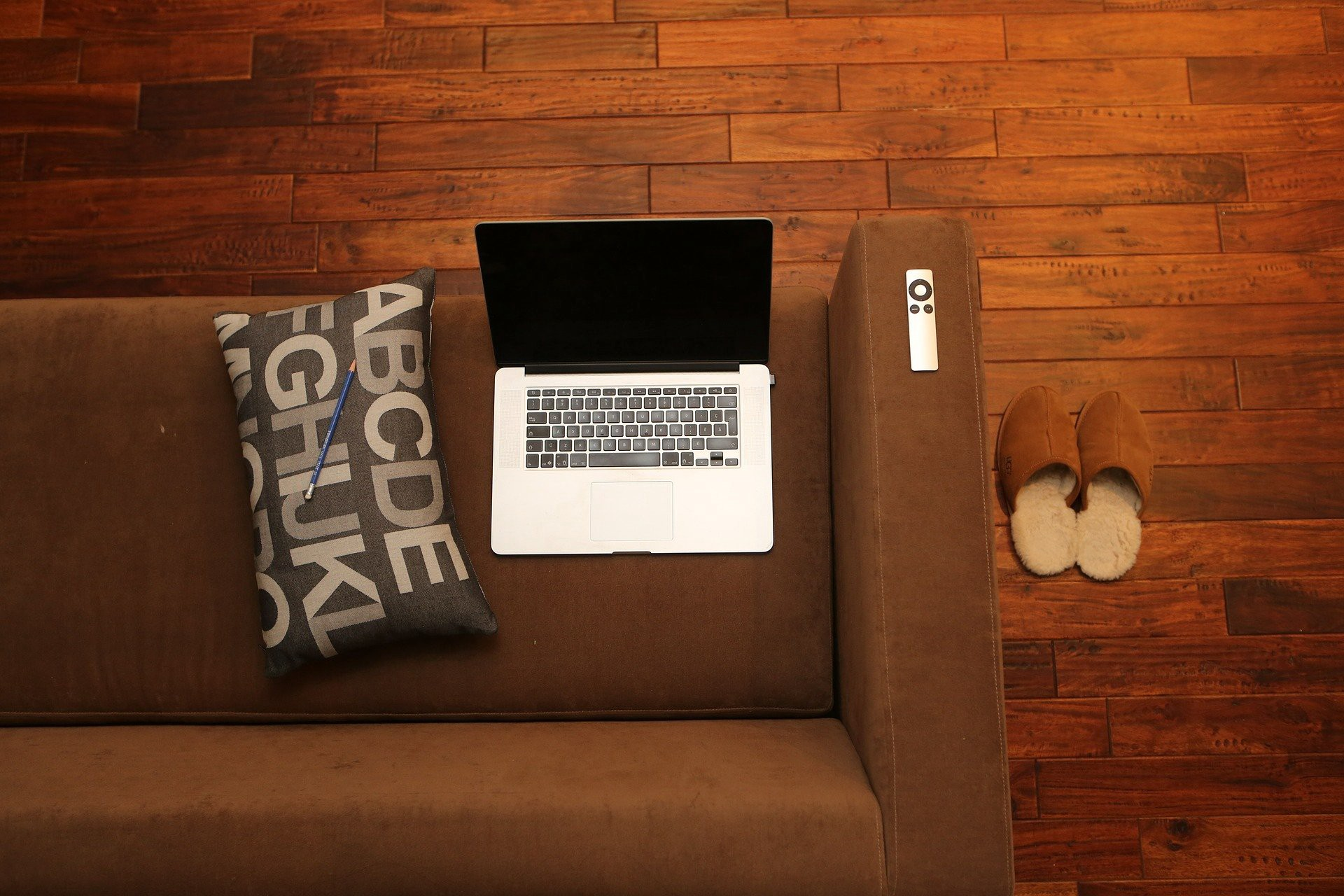Laptop on a brown sofa