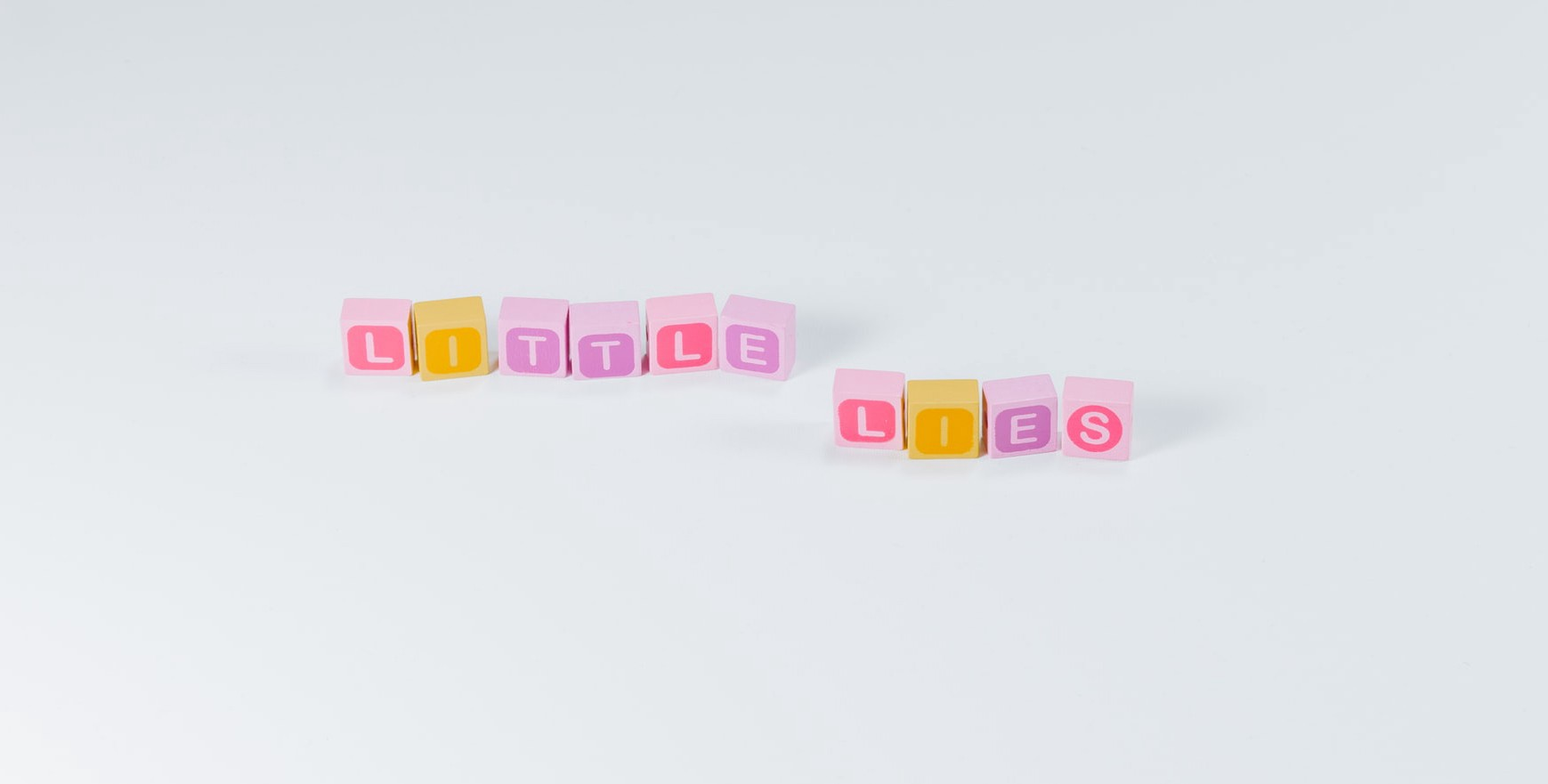 Colorful blocks of letters arranged to spell out the phrase little lies.