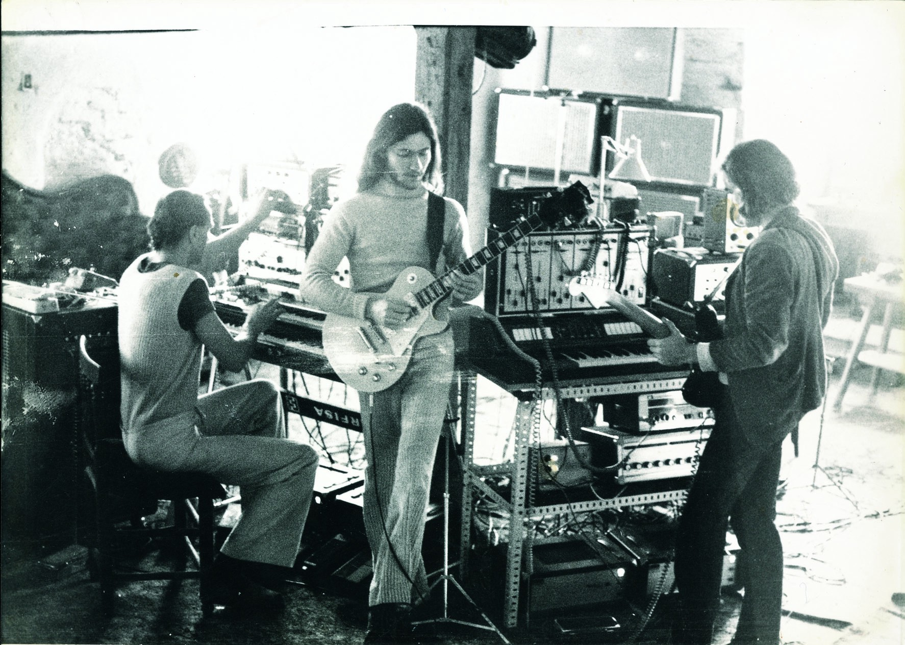 The band, Harmonia, gathered around several keyboards and modular synthesizers, performing a song