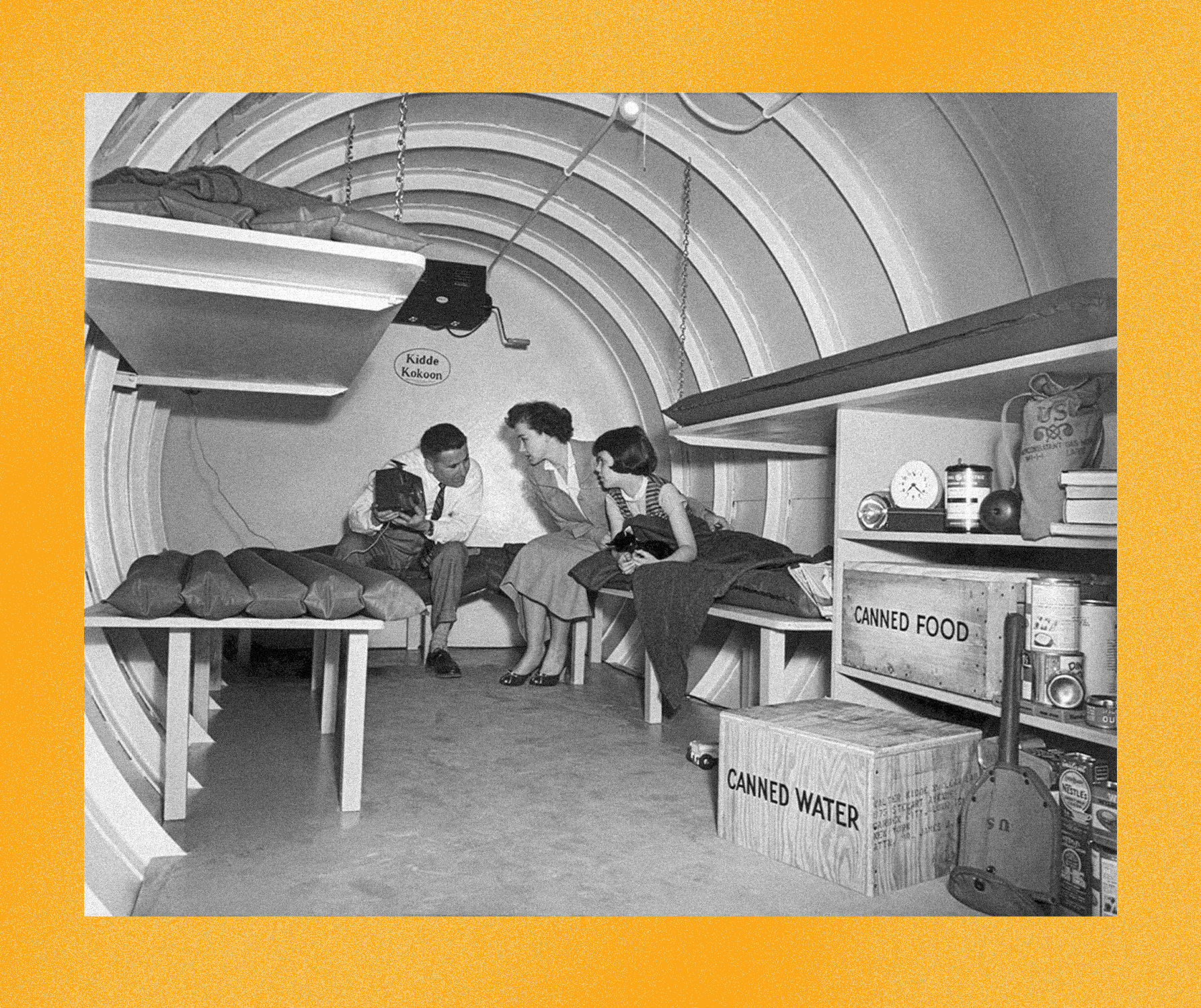 An archival photo of a family hiding out in a bunker.