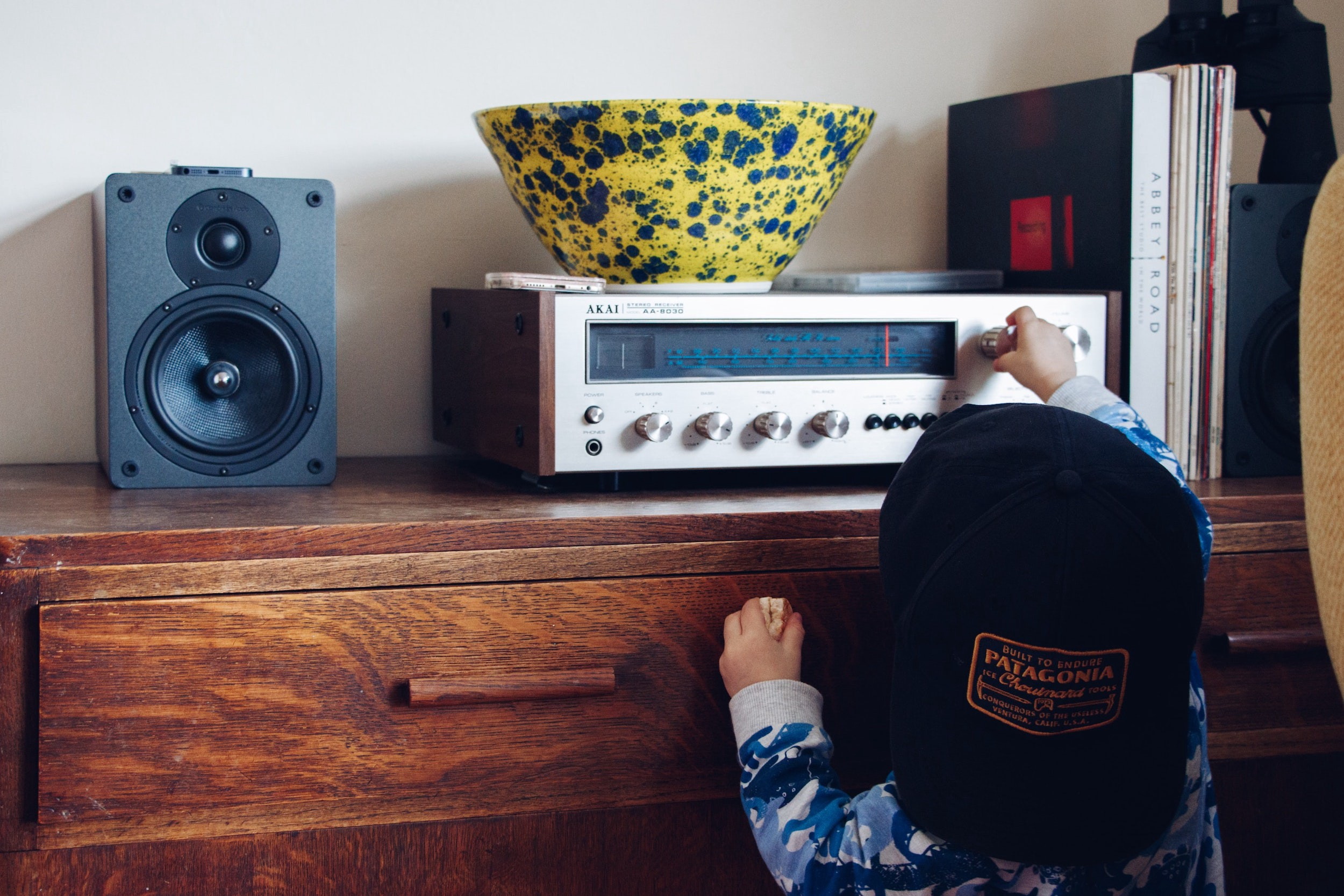 Toddler adjusts dial on classic radio