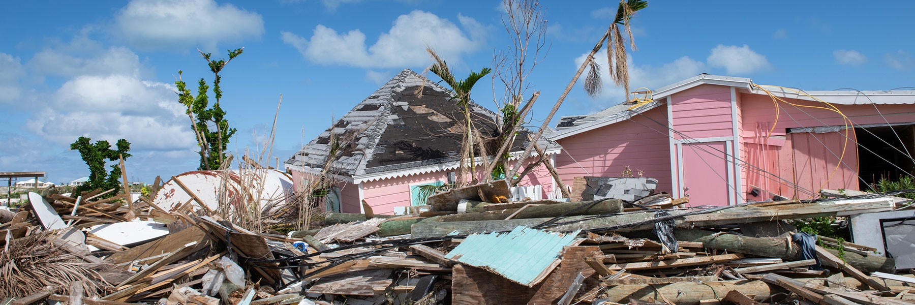 In The Bahamas a pink house and a pile of construction rubble stands in ruin after being hit by hurricane Dorian.