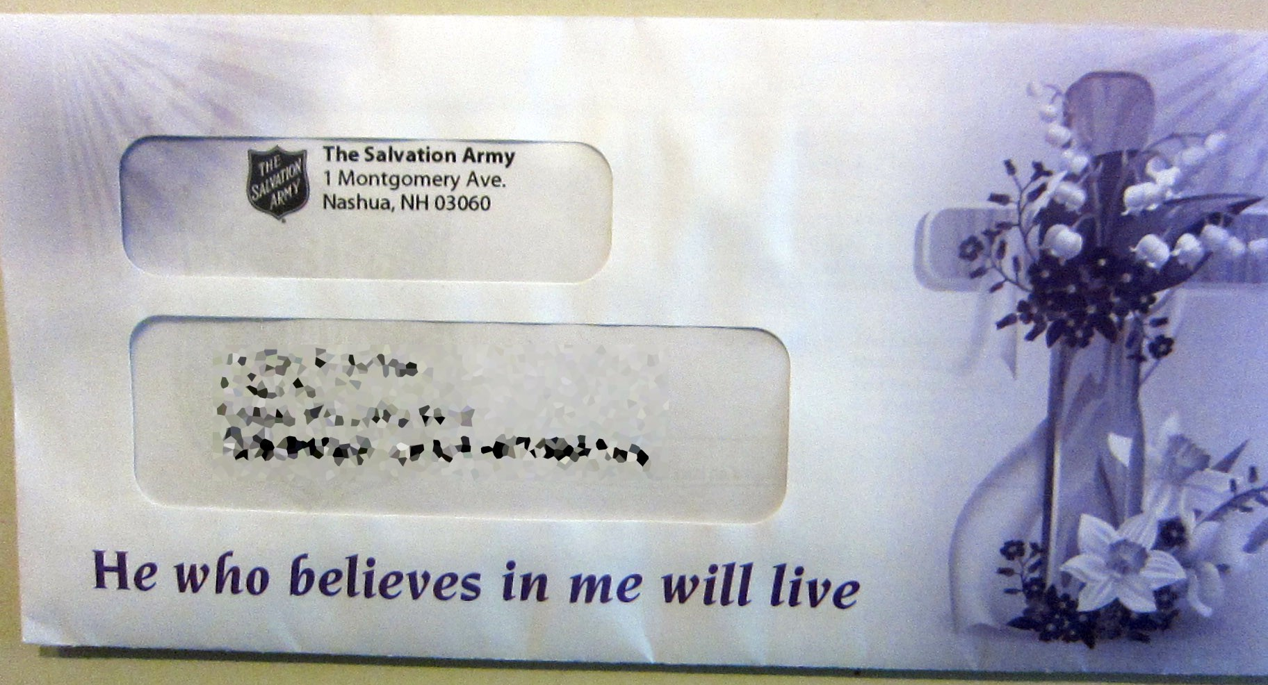 """Envelope from Salvation army with cross and text: """"He who believes in me will live"""""""