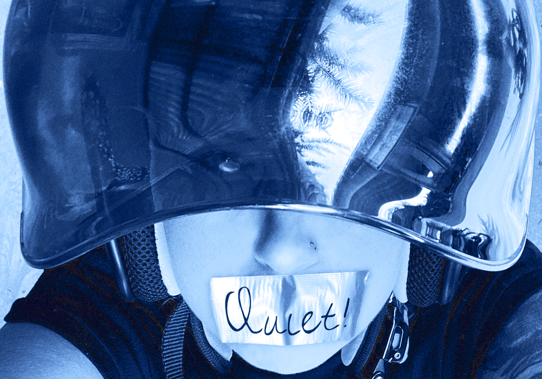 Wearing my motorcycle helmet with duck tape over my mouth, on the tape it says 'Quiet!'