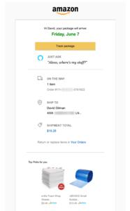 """Screenshot of Amazon.com shipment-tracking email. The email only describes the order as an order number, never states the contents of the order, but does advertise two """"Top Picks for you"""" suggestions."""