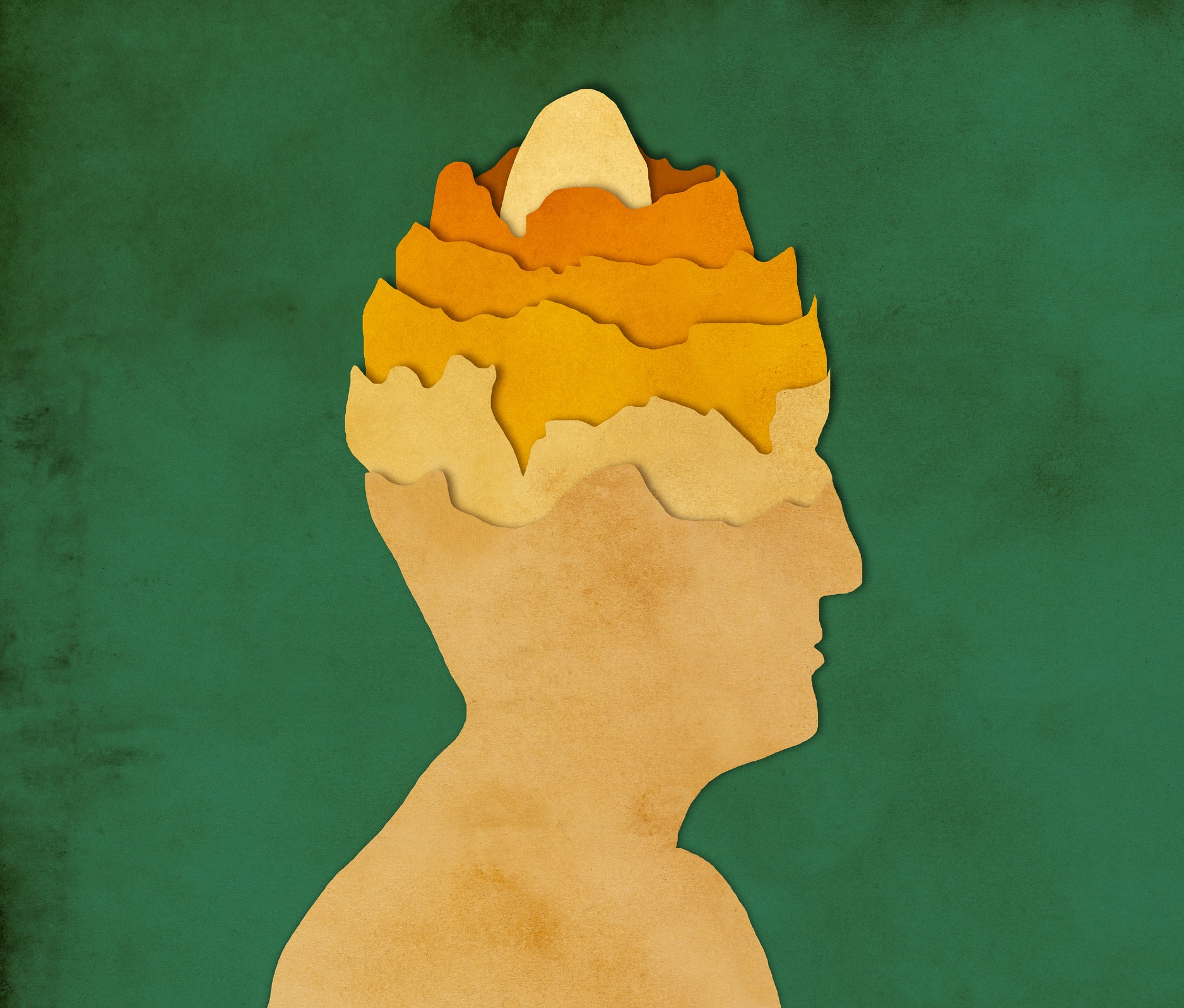Paper-cut image of layers of a man's head, with egg at the core.
