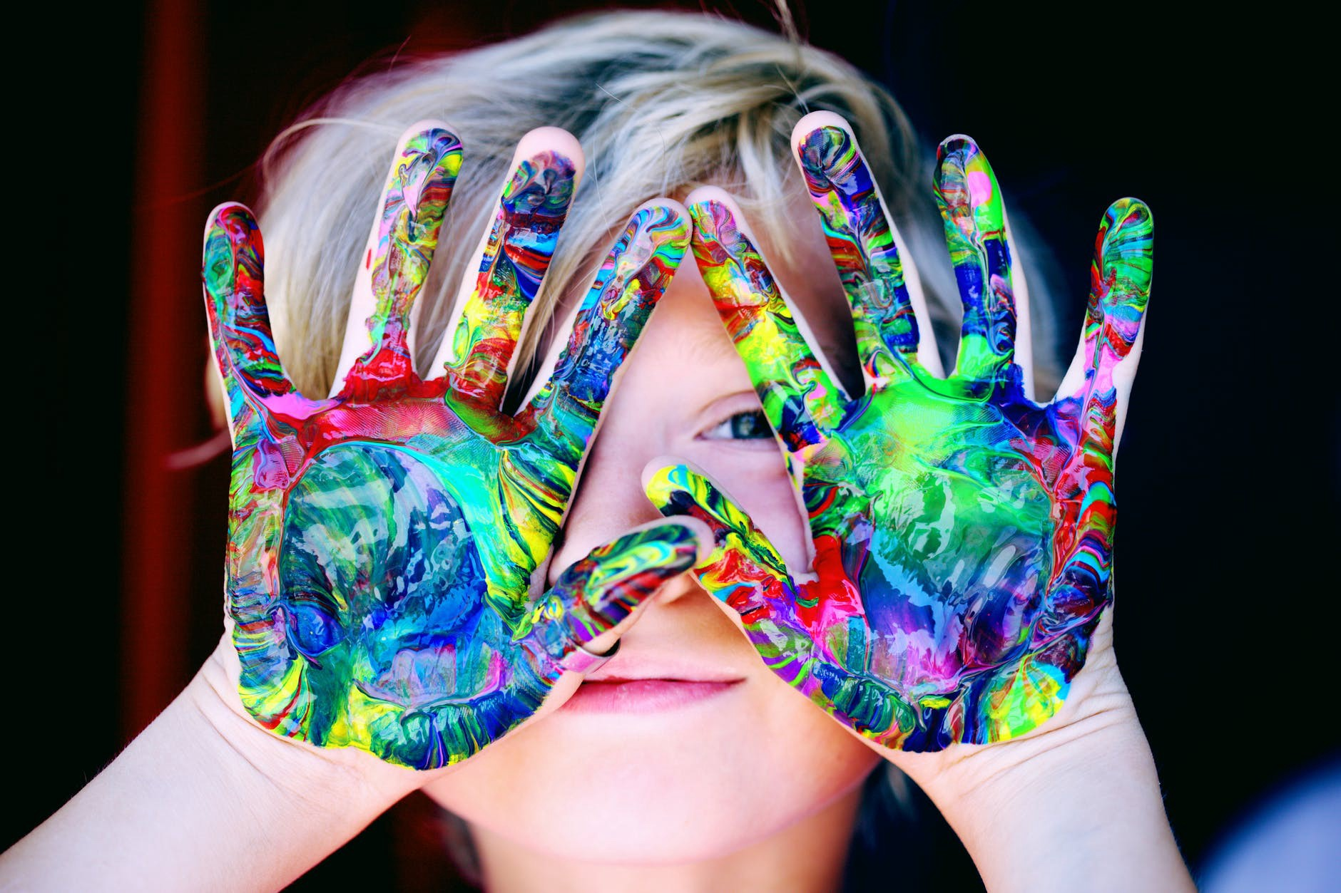 Photo of child with paint on hands