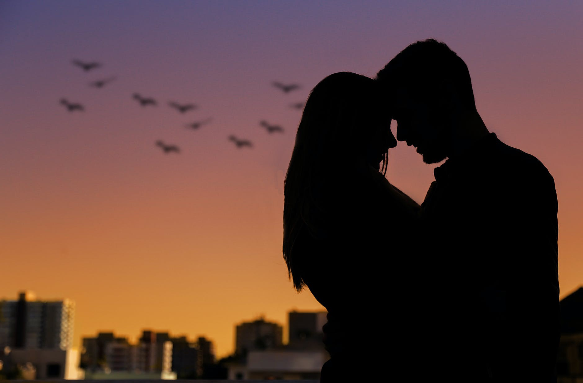 Man and woman looking at each other during a beautiful sunset