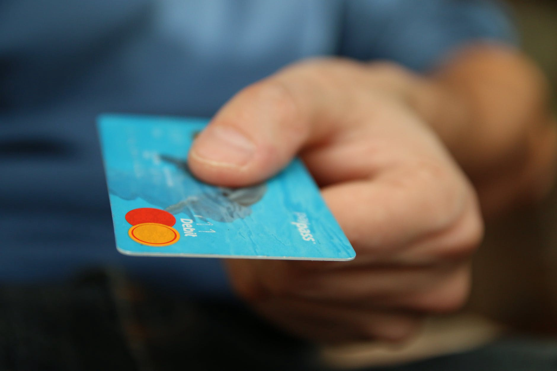 Person holding out a credit card