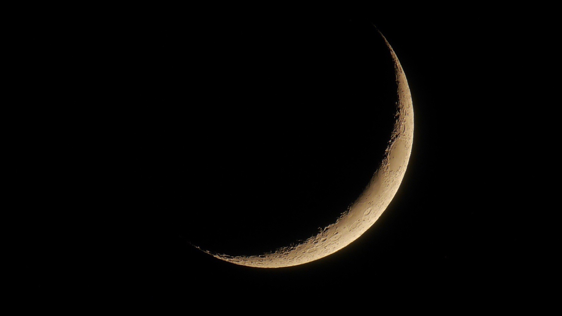 A thin young waxing moon