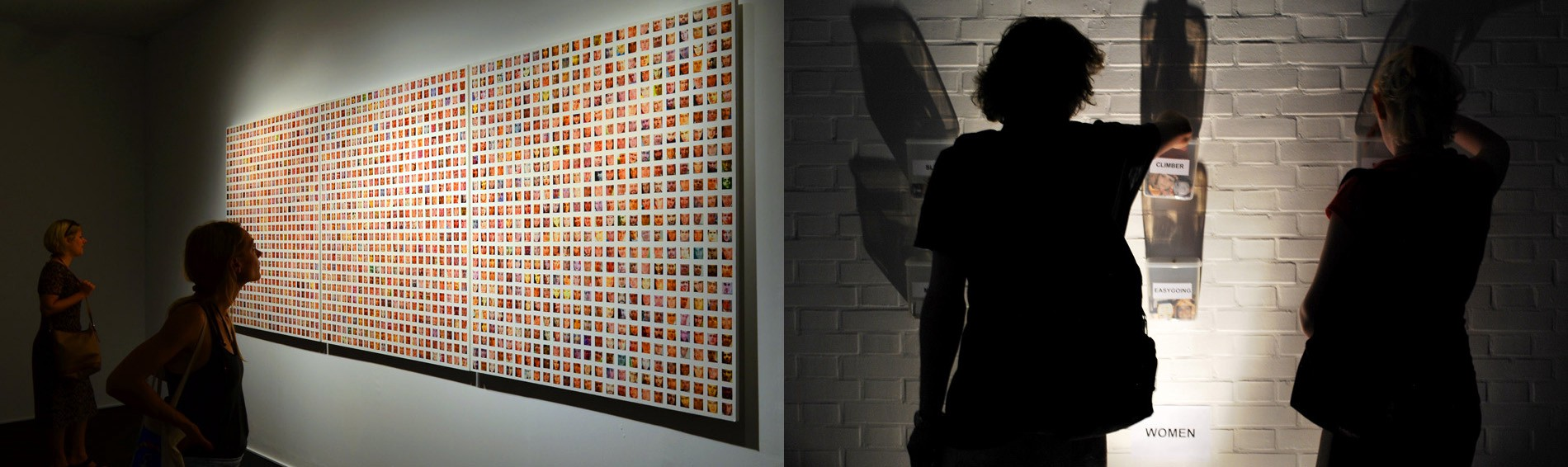 Large grid of faces on gallery wall, two people select small face chips from buckets on gallery wall.