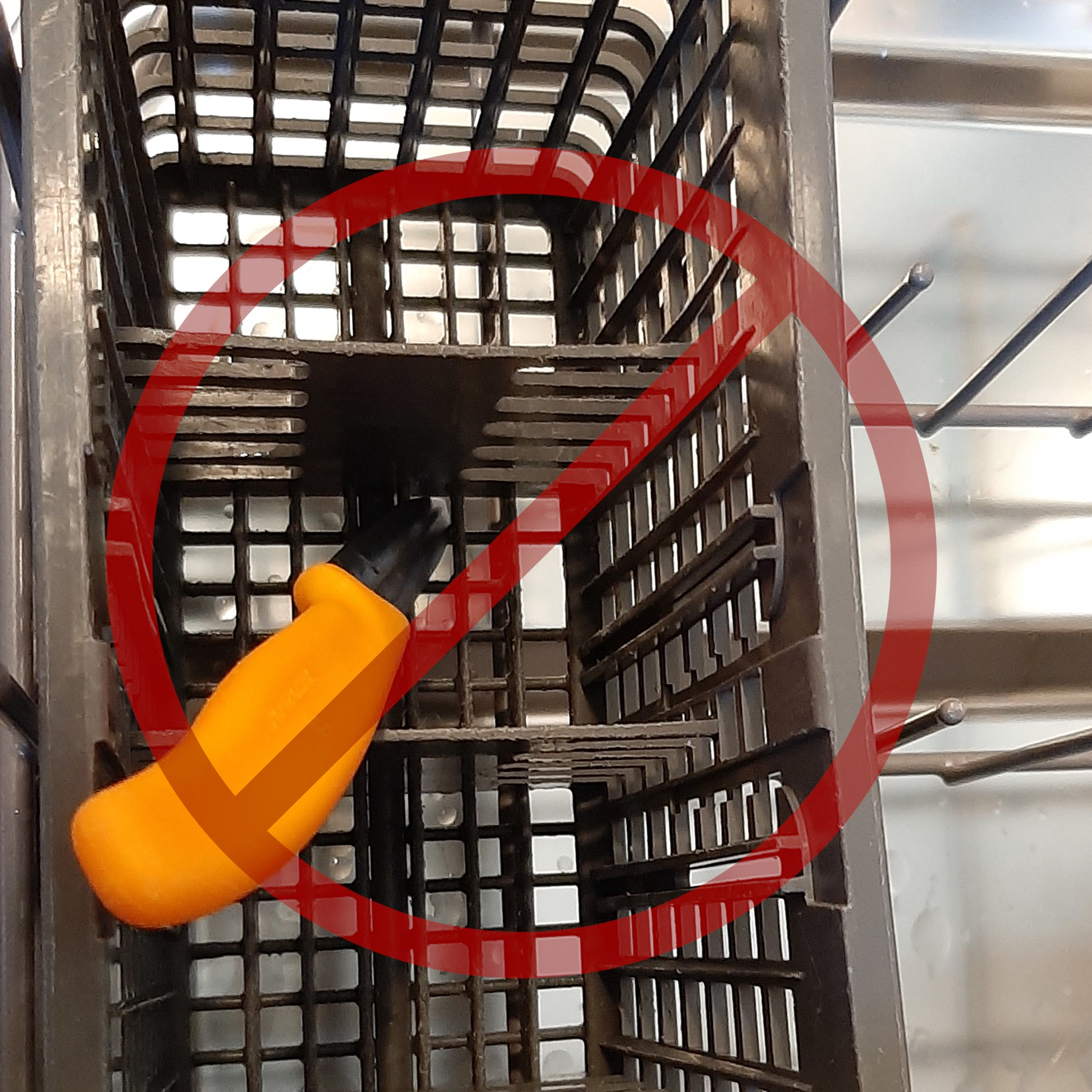 Point down knives have damaged this basket, and risk stopping the sprayer