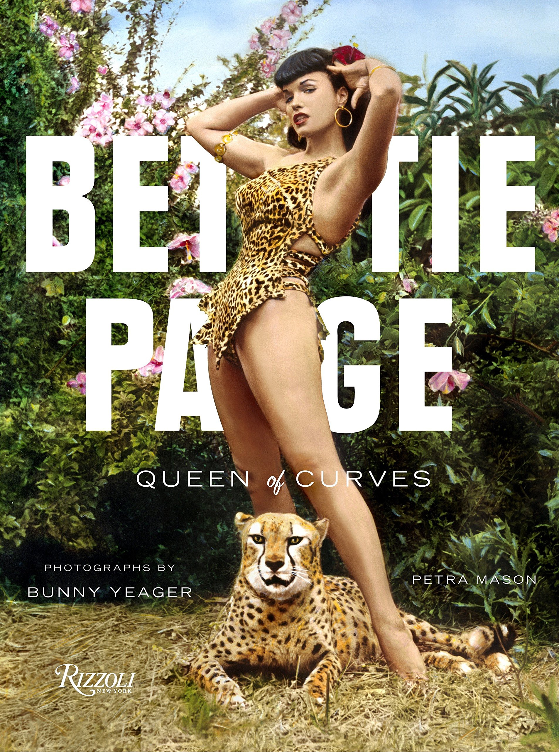 Book cover of Bettie Page: Queen of Curves that shows her posing in her leopard print swimsuit while standing over a cheetah