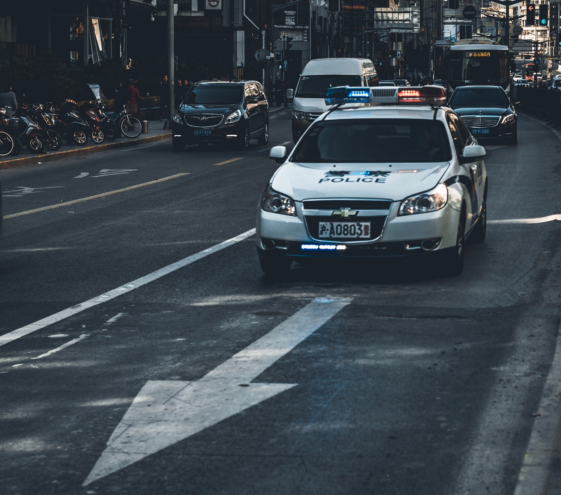 A patroling police car driving down the street