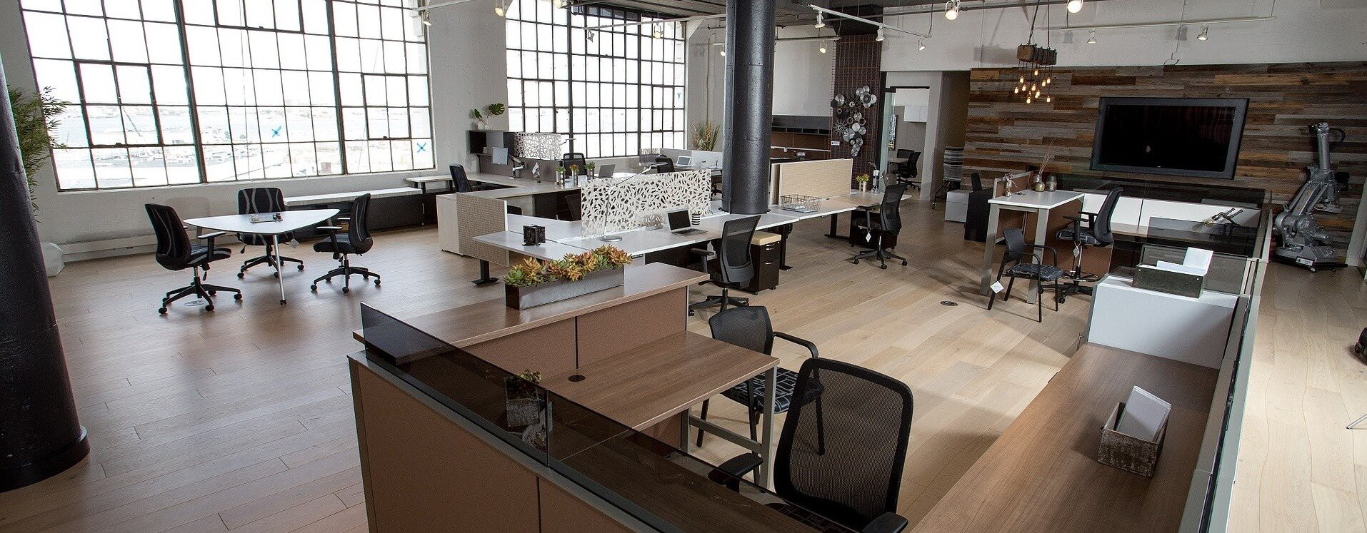 Bright, clean office with plenty of space around the workstations