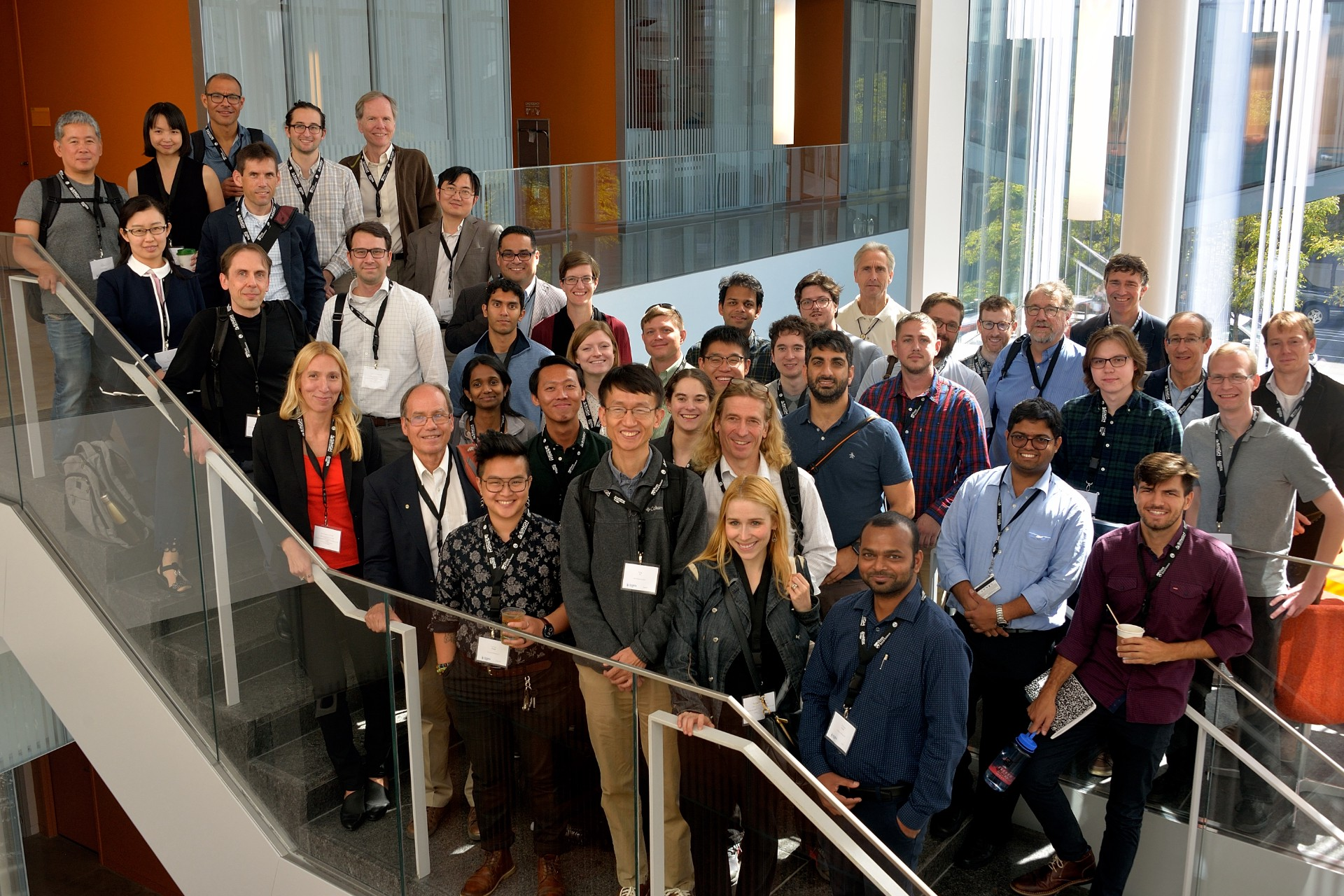 A large contingent of quantum scientists pose for a group photo on the stairs of the Singh Center for Nanotechnology