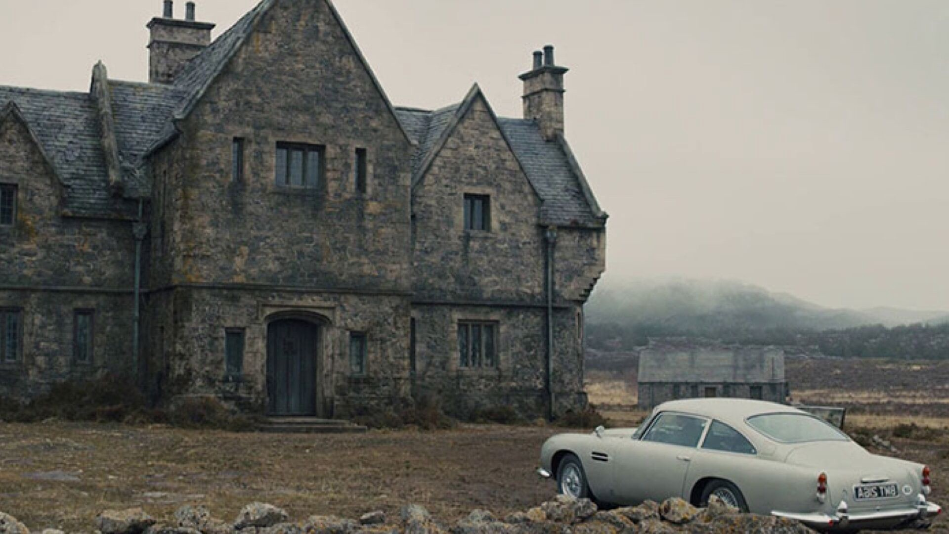 Establishing shot for the finale to the film, Skyfall. The classic Bond car sits in the foreground to a misty stone cottage.