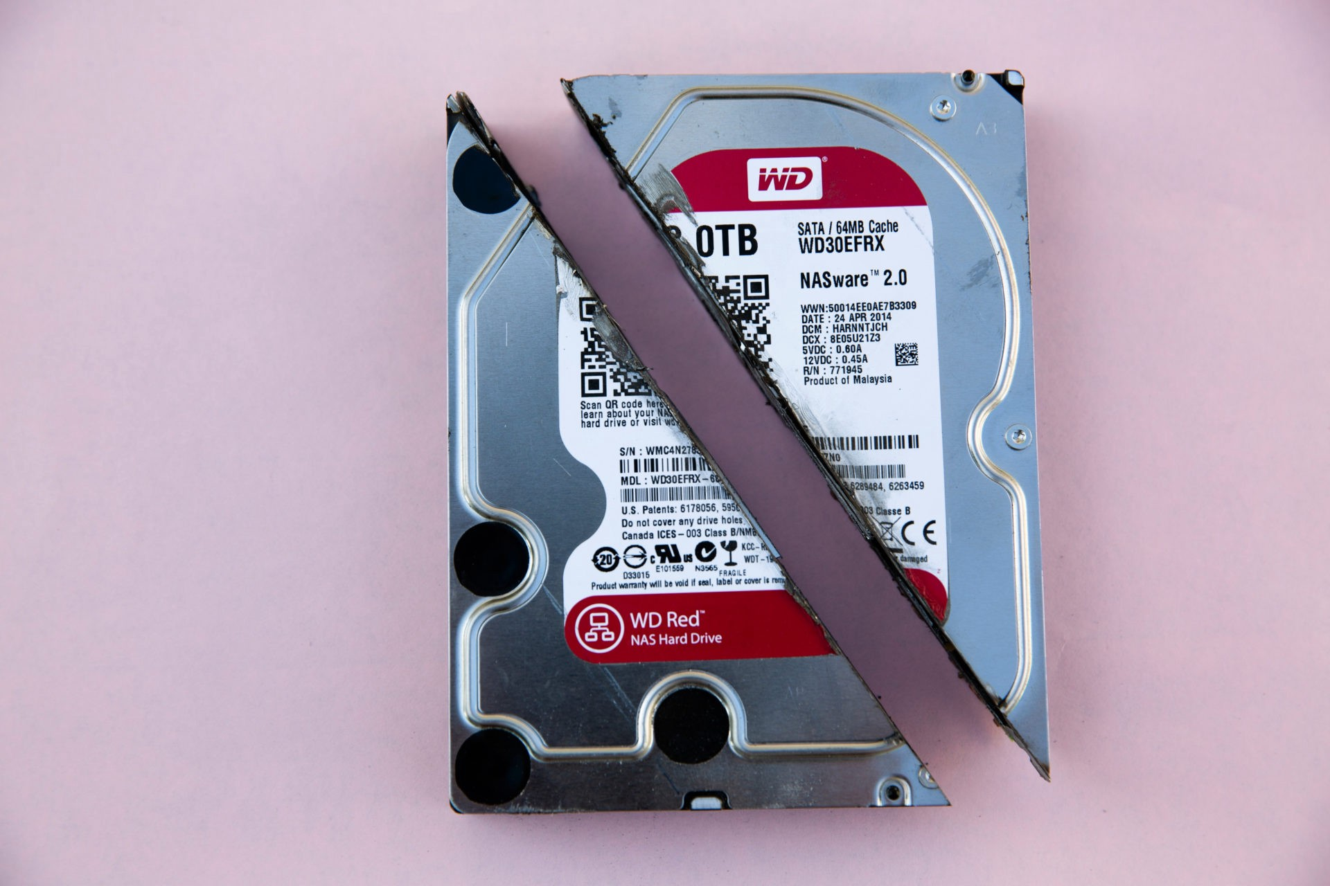 A physical hard drive disk destroyed by cutting it in half diagonally . Backup files with rclone