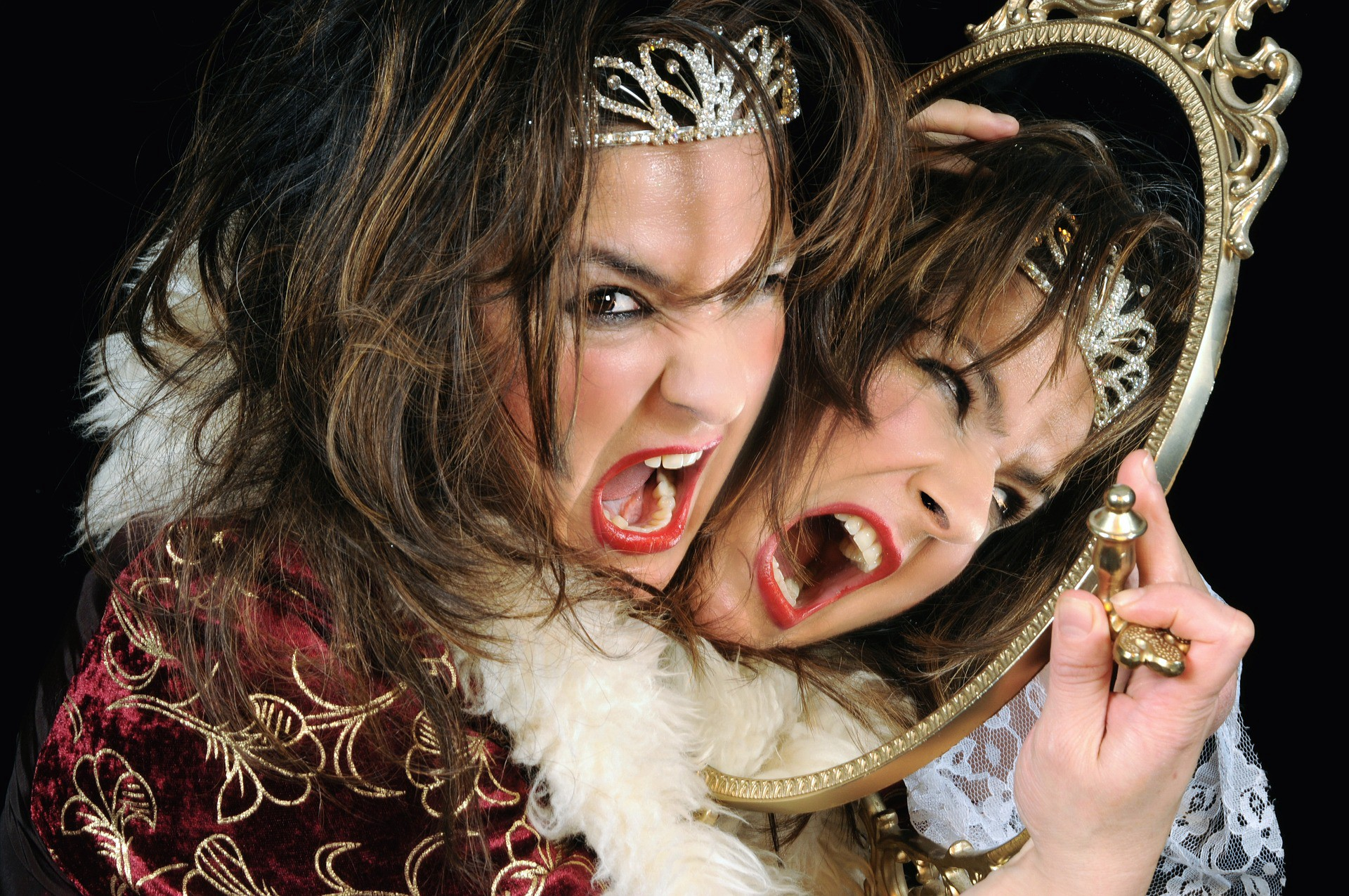 enraged narcissistic woman holding mirror to face