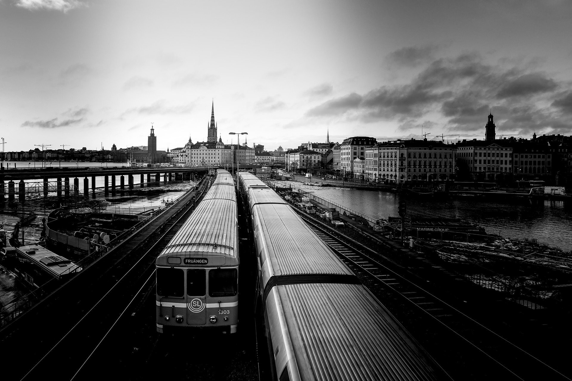 Two trains pulling out of Stockholm