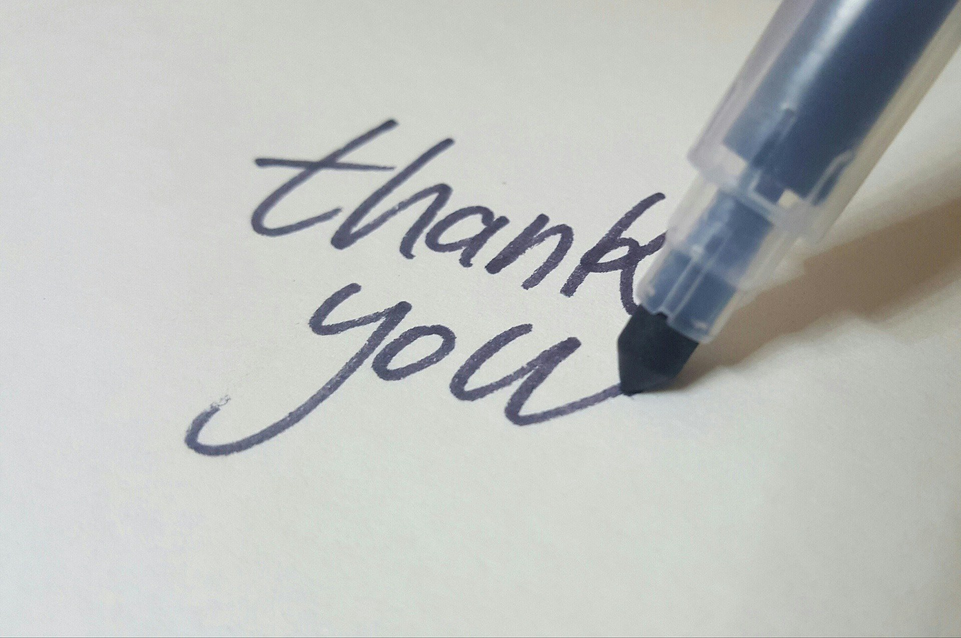 Thank you written on a piece of paper
