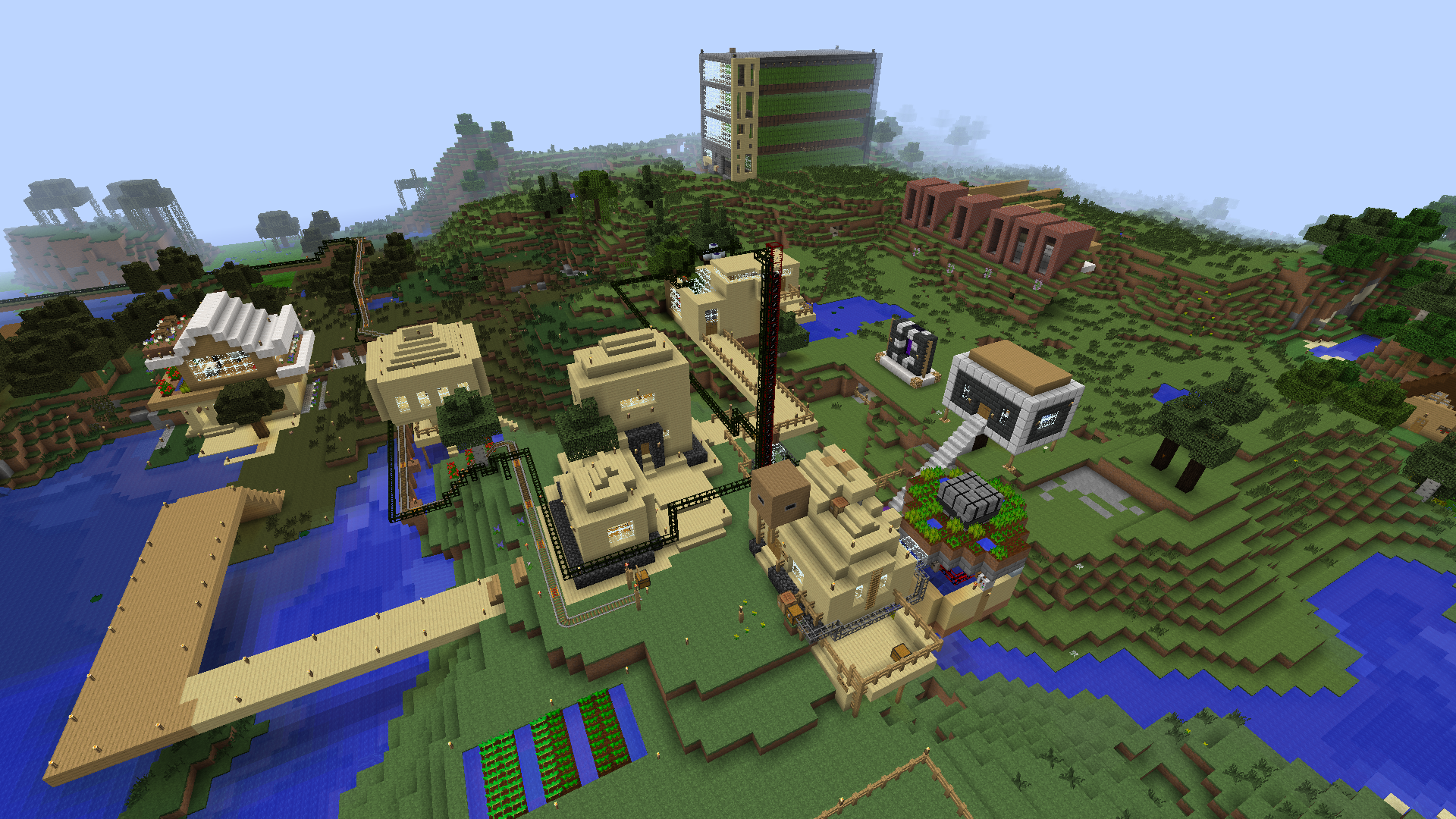 A picture of our city in Minecraft, with many large buildings and pipes full of oil passing right trough.