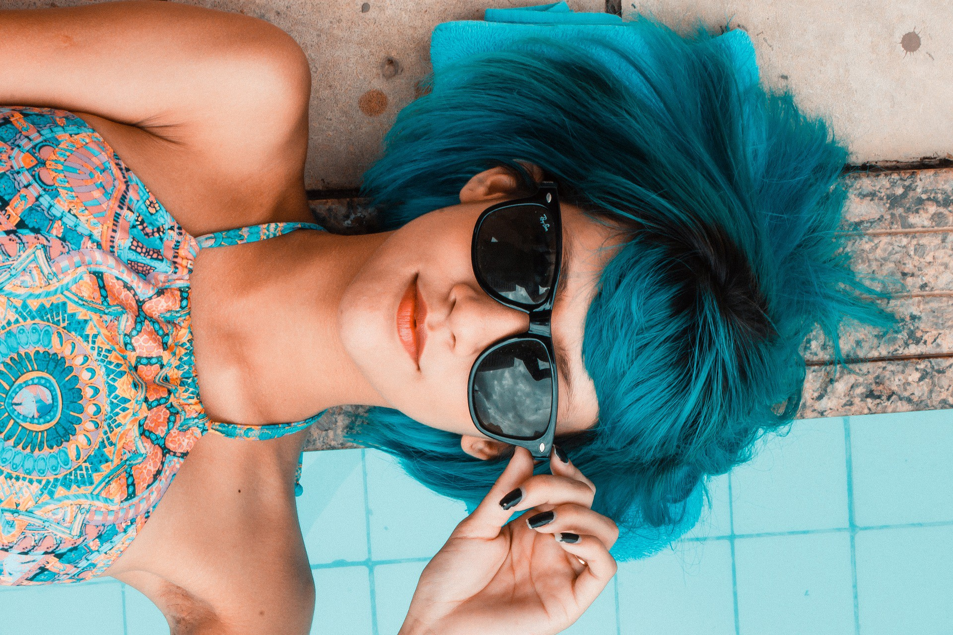 Woman with blue hair lying beside a pool. What Can Using a Dishwasher Teach Us?