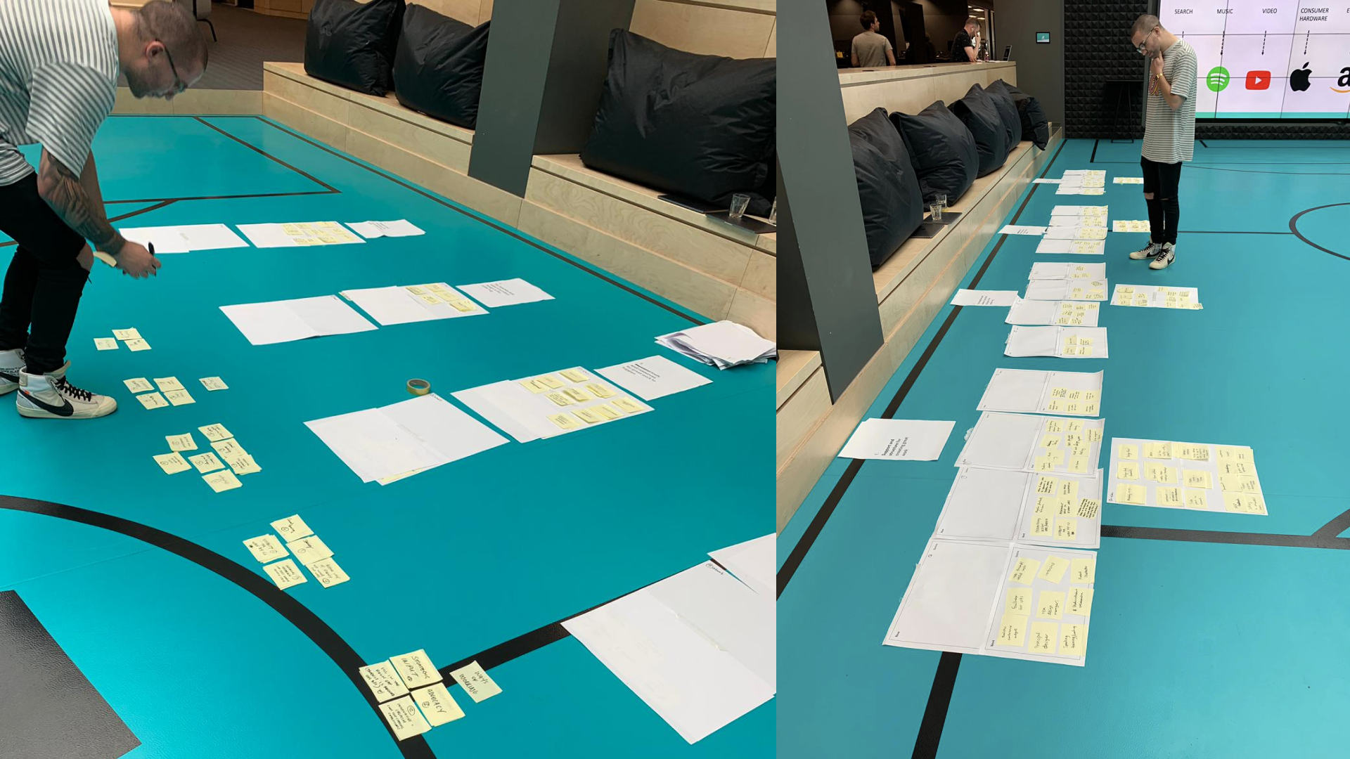 A person analysing a bunch of post-its, on the floor. Because why not.