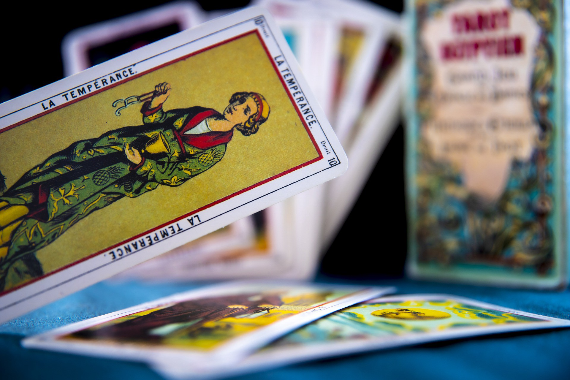 Photo of the Temperance with other tarot cards out of focus in the background