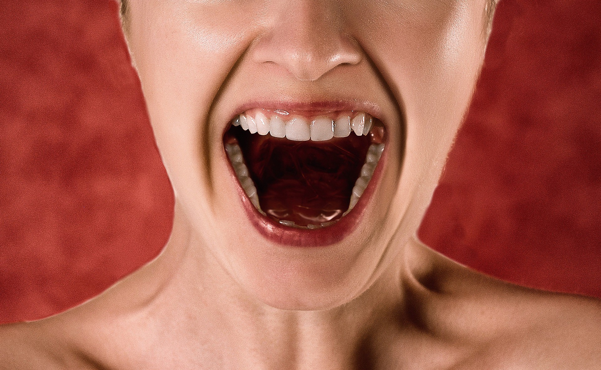 Woman shouting. How to Write Stories That Grab Your Readers by the Throat.
