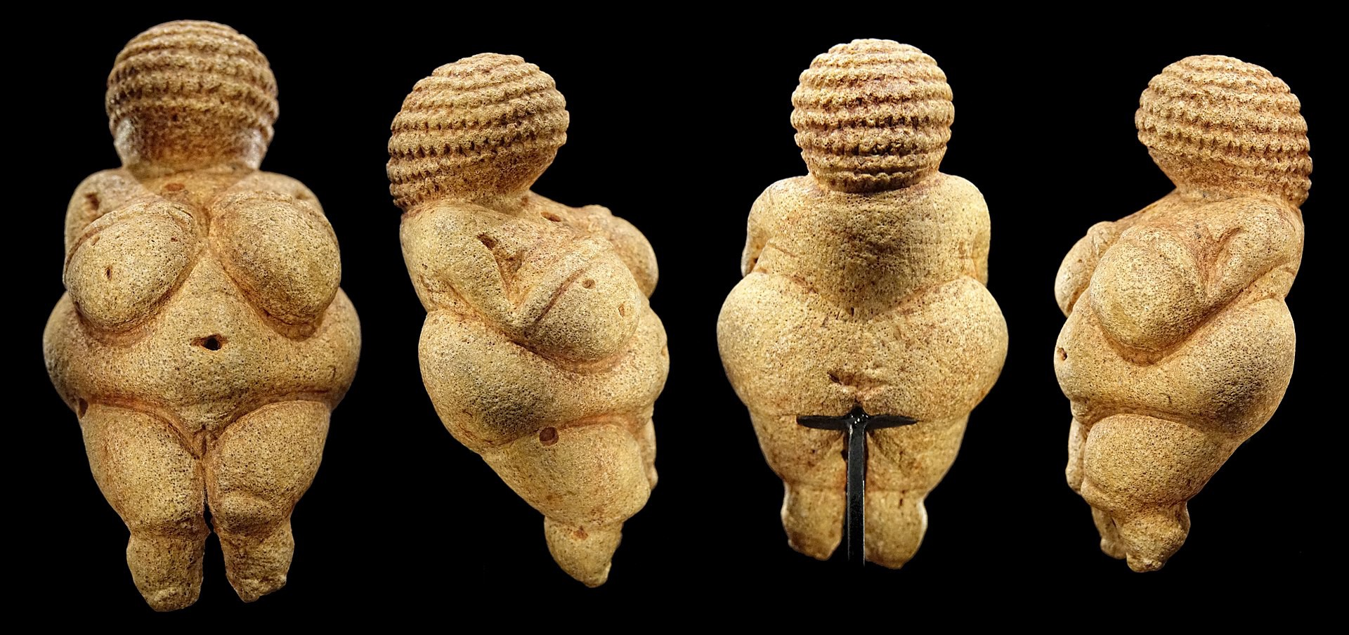 Venus of Willendorf, a small fertility goddess sculpture with exagerated head, breasts, and hips.