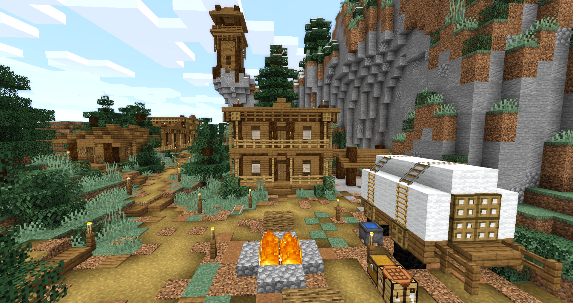 A Minecraft screenshot of a western style building and a wagon next to a campfire.