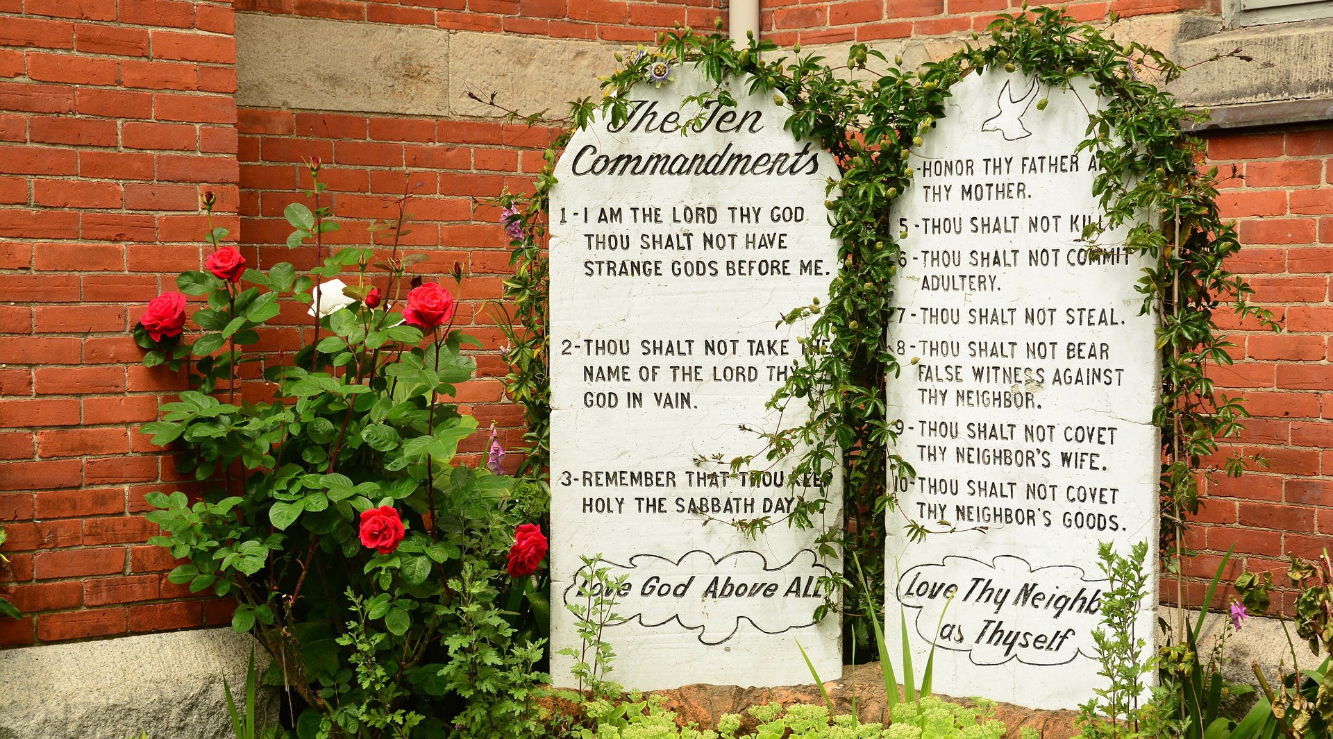 10 Commandments on tablets in a garden