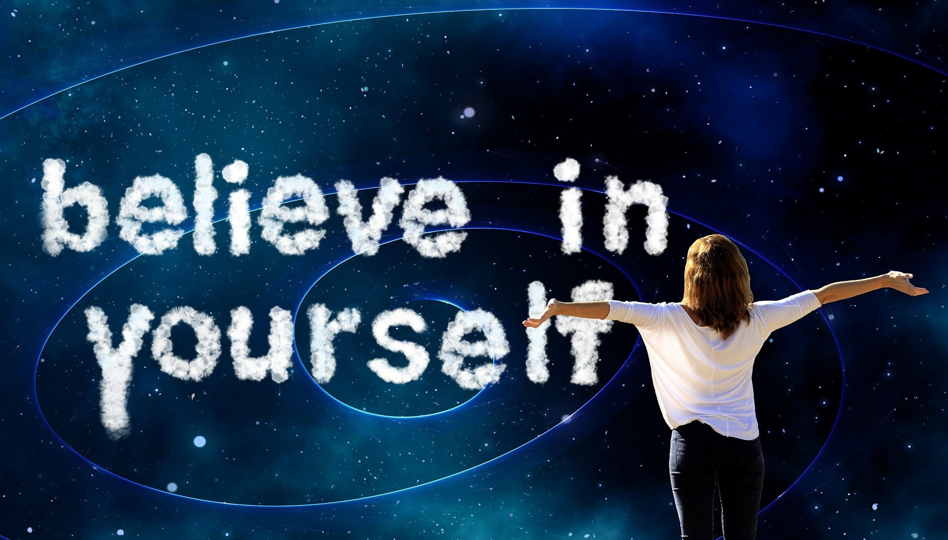 Woman looking at the message believe in yourself