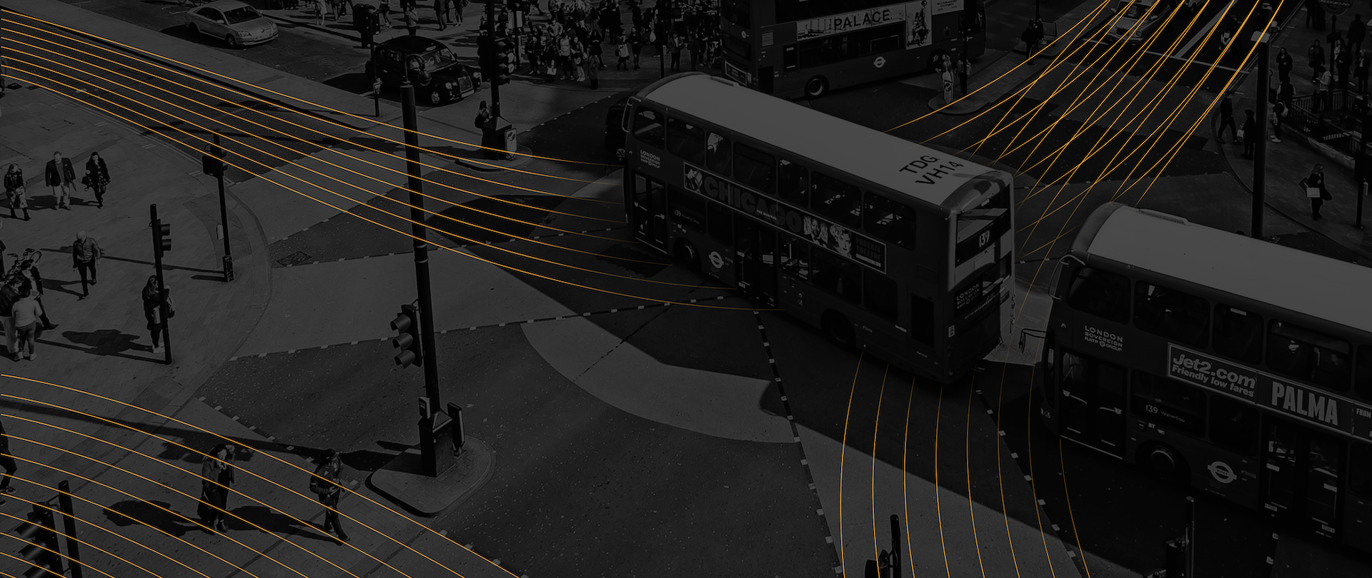 Smart city intersection showing converging lines representing autonomous vehicle traffic