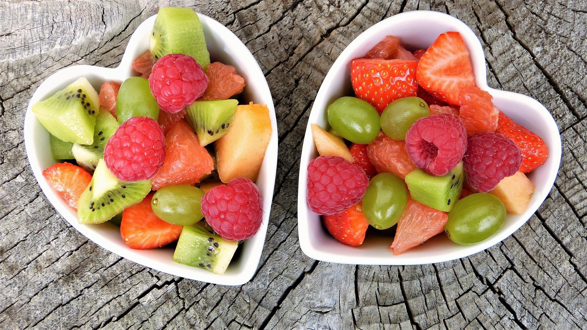 Healthy fruits in two heart-shaped bowls
