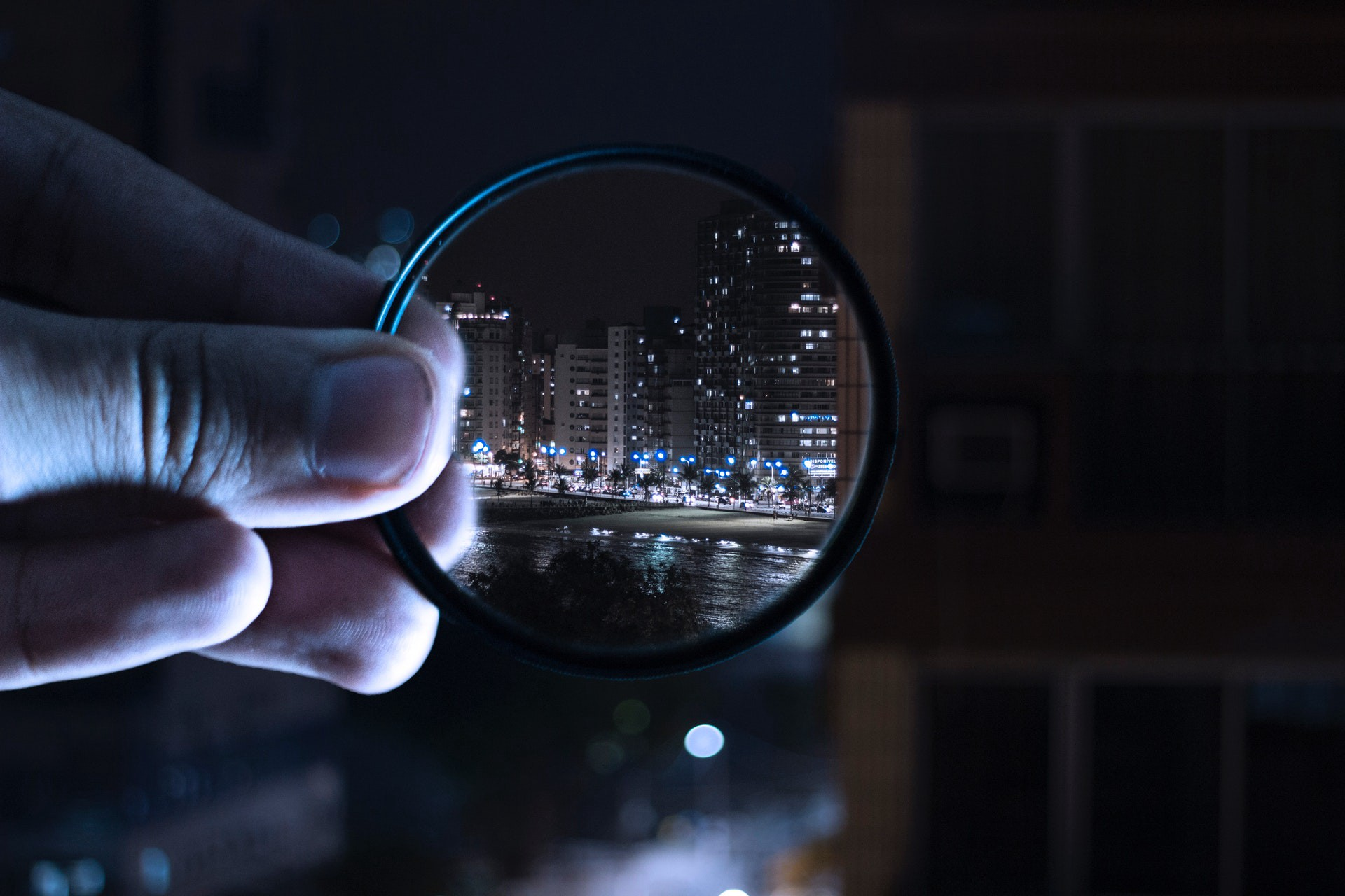 Someone is looking at the city through a magnifying glass