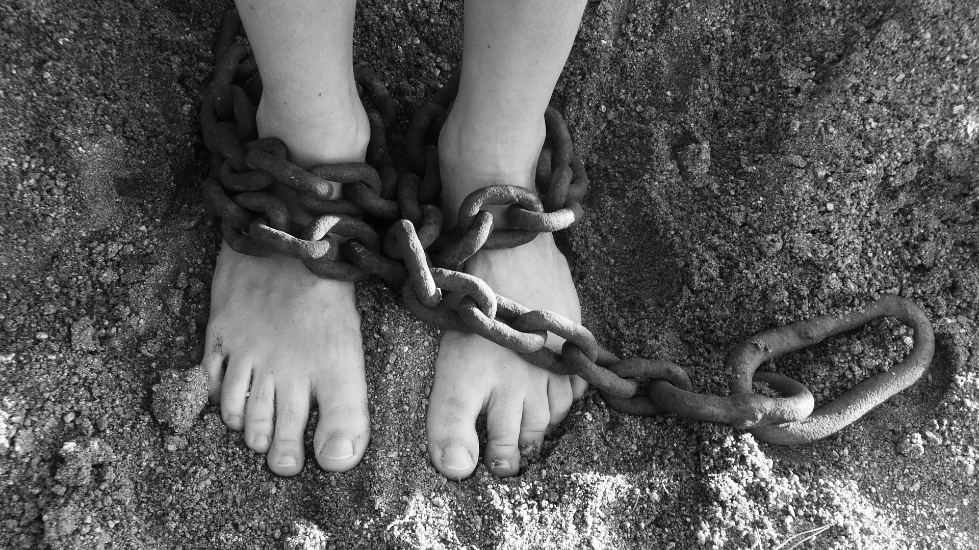 legs and feet in chains