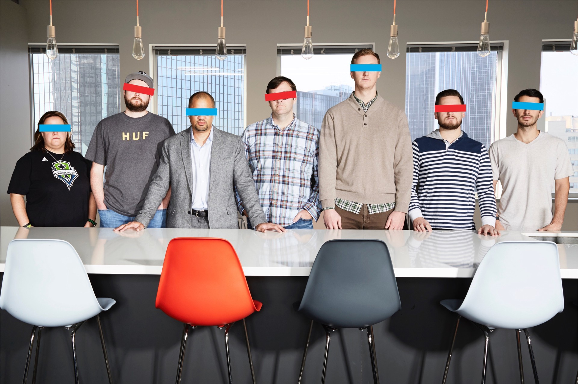 Photo of the seven person creative team at 70kft. They have bars as a graphics over their eyes, to obscure their identities.