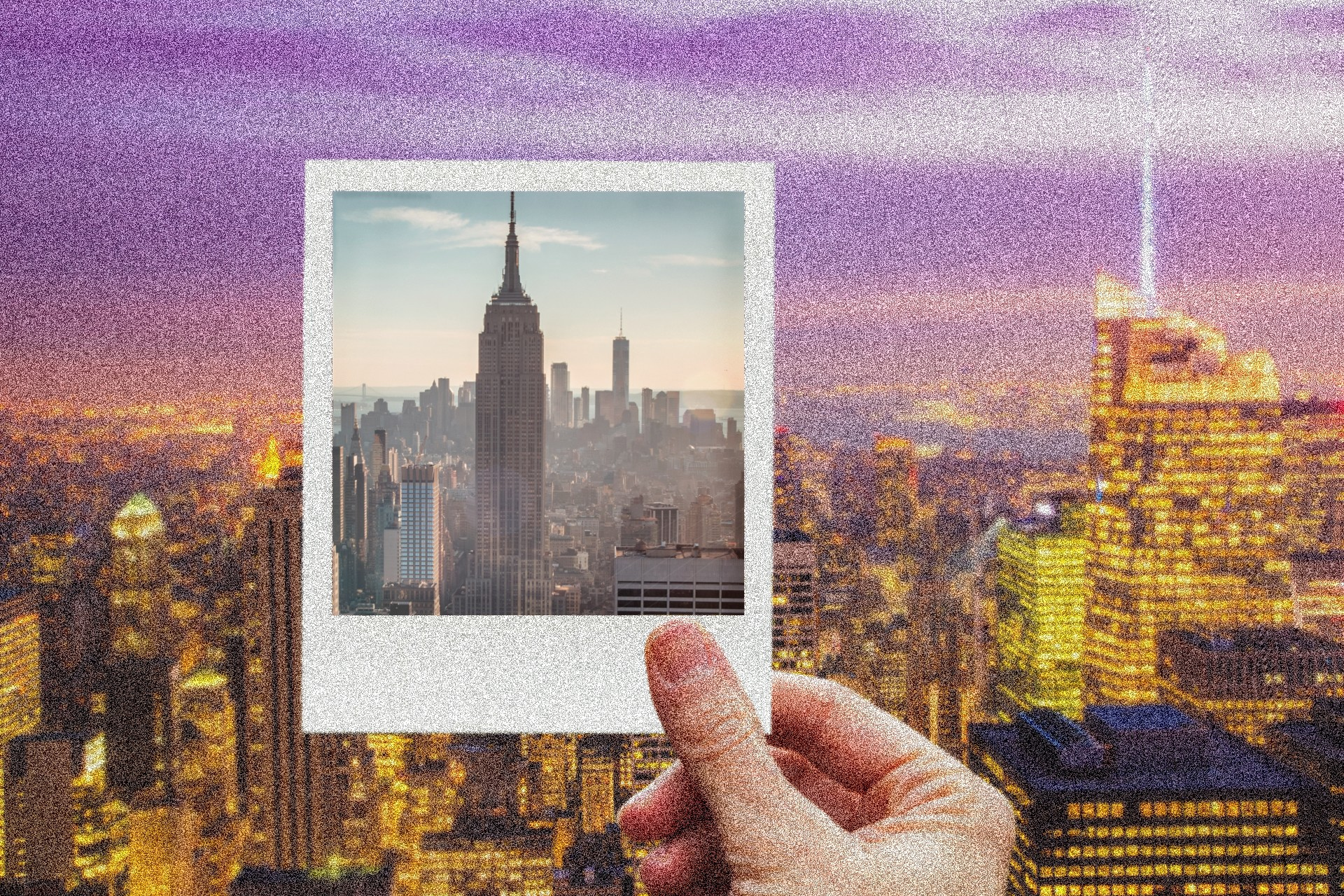 A hand holding a Polaroid photo of NYC up to the NYC skyline at evening.