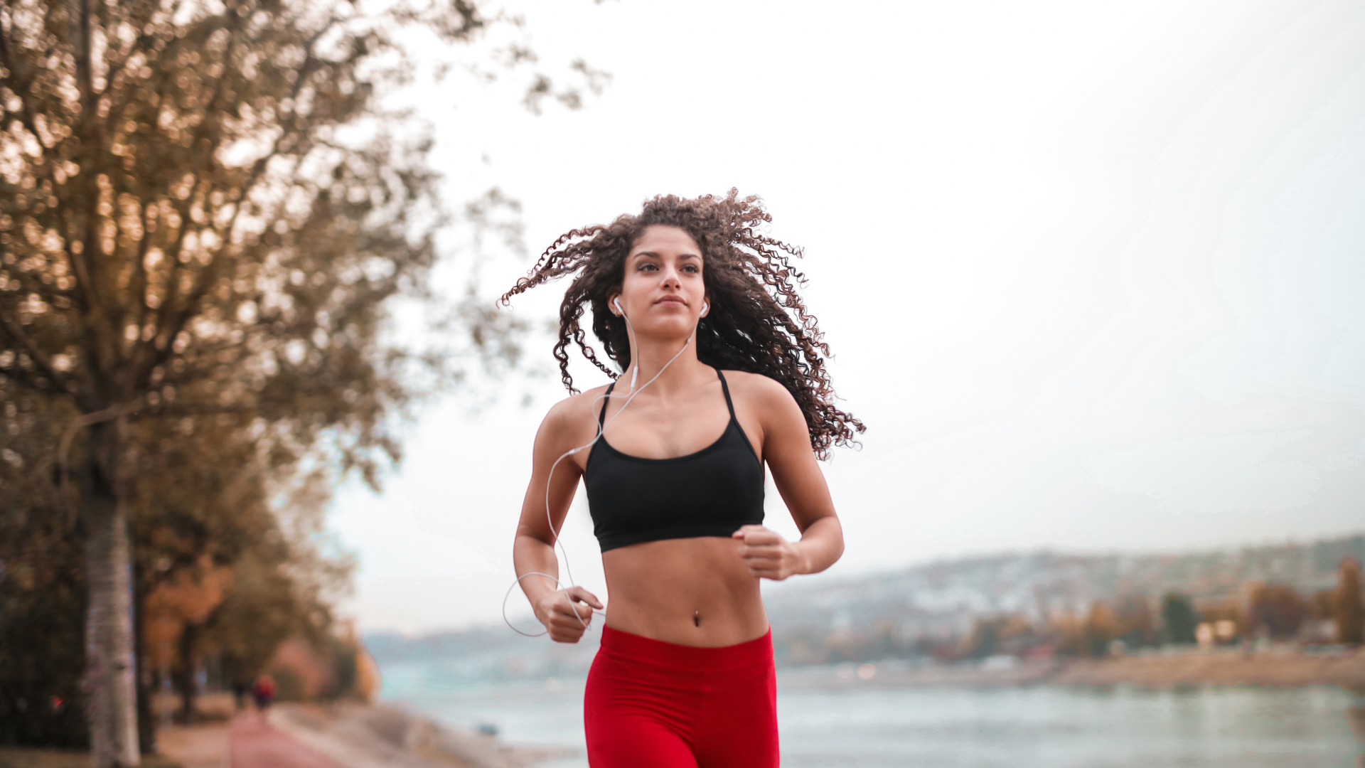 An individual running with headphones in