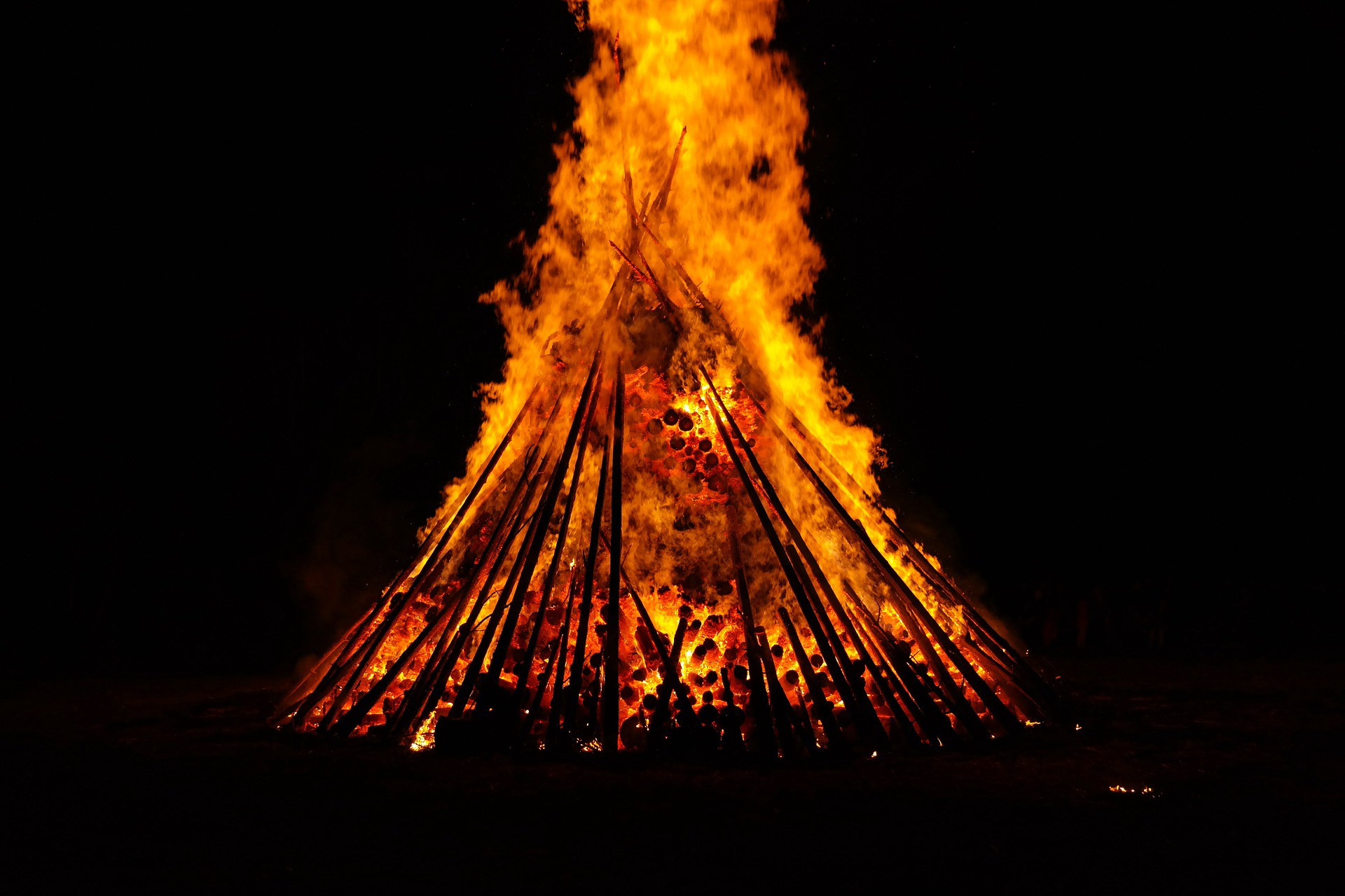 A huge campfire in the night.