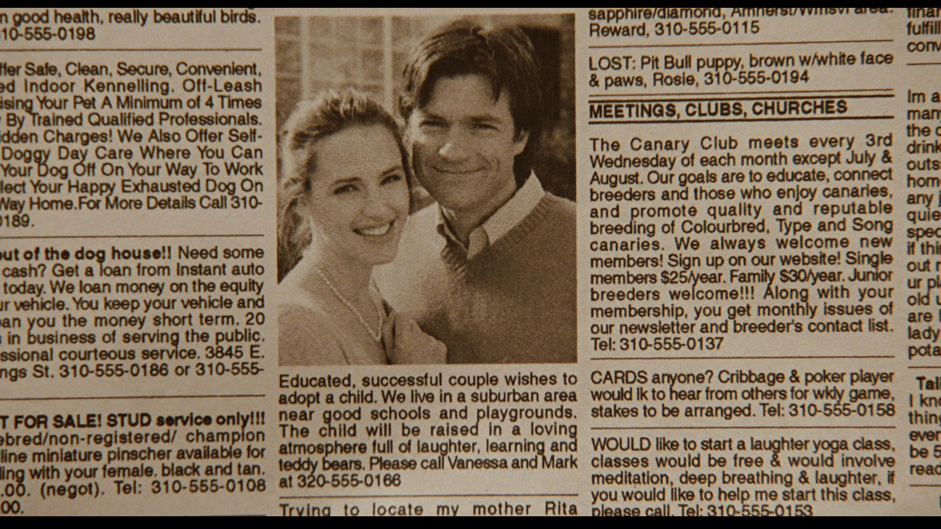 Close-up of a sepia-toned newspaper with a photograph of Mark and Vanessa Loring in the center.