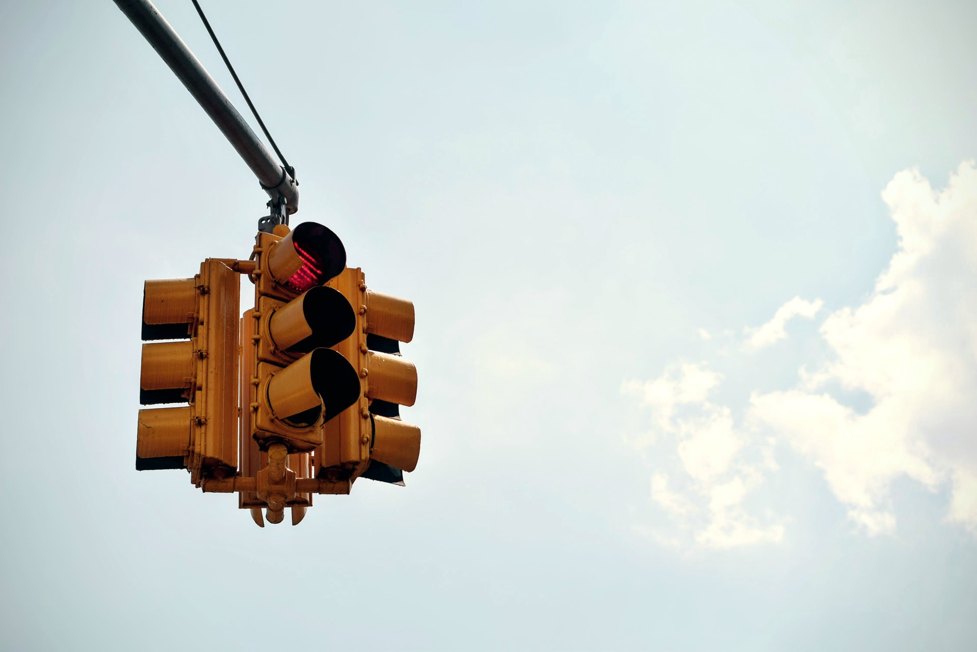 Stop light with the top, red light illuminated.