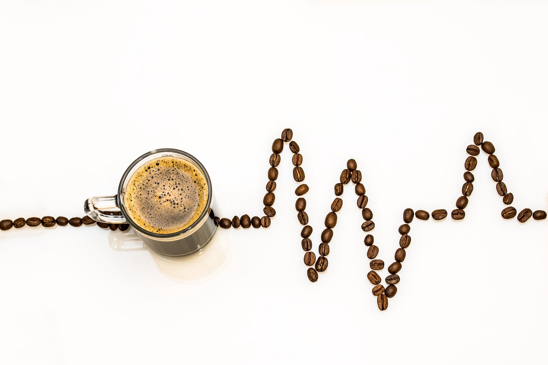 cup of coffee completing heartbeat graph showing stressing out