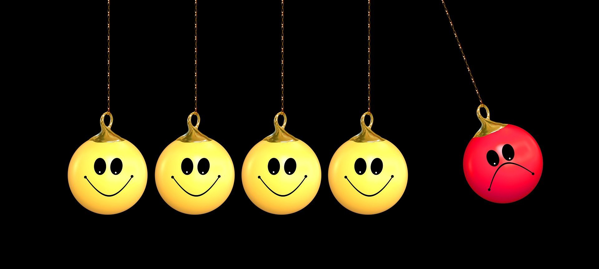 Group of smiling balls in a line. One sad ball is going to bounce the other balls.