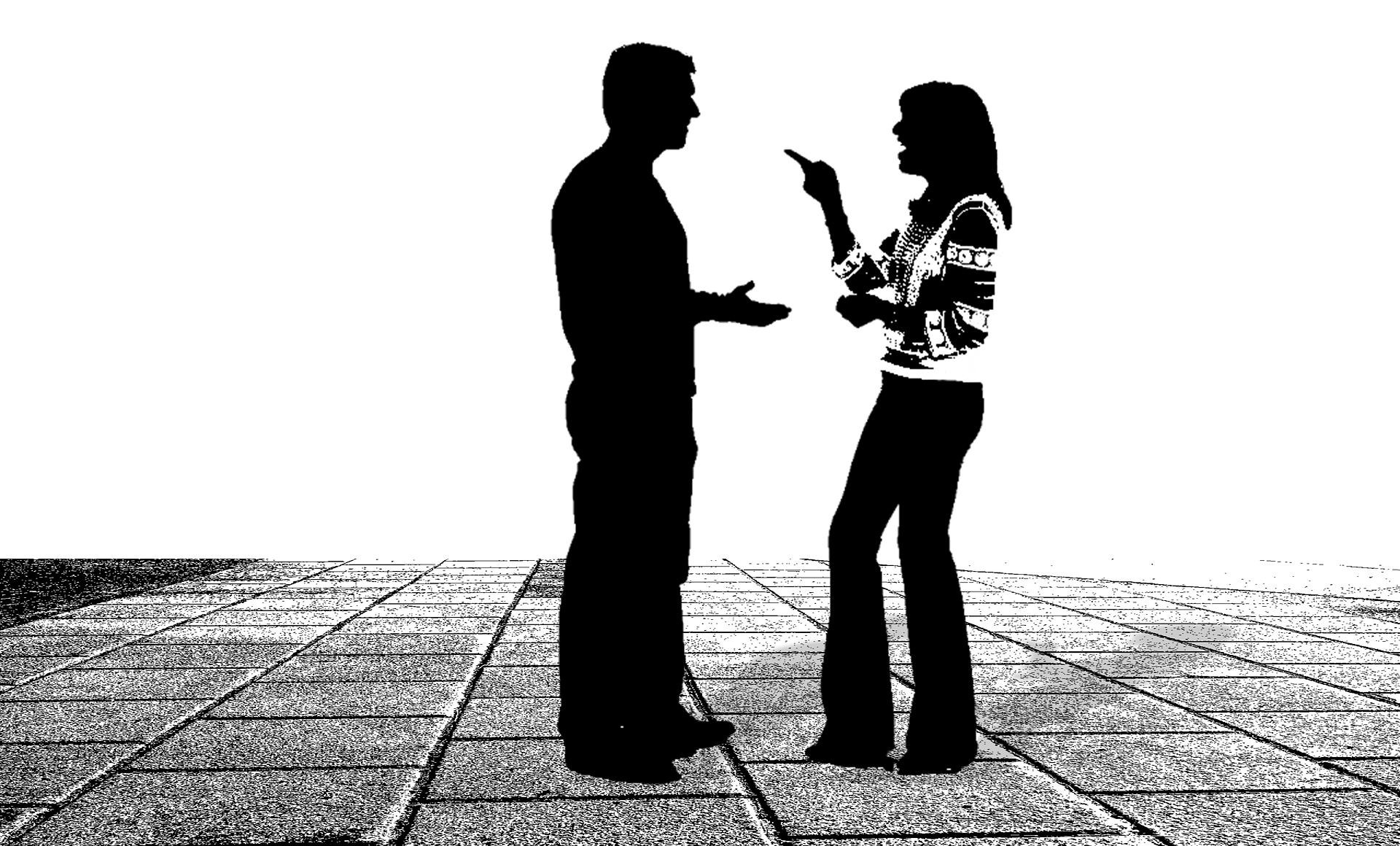 The silhouette of a man and a woman having an argument.