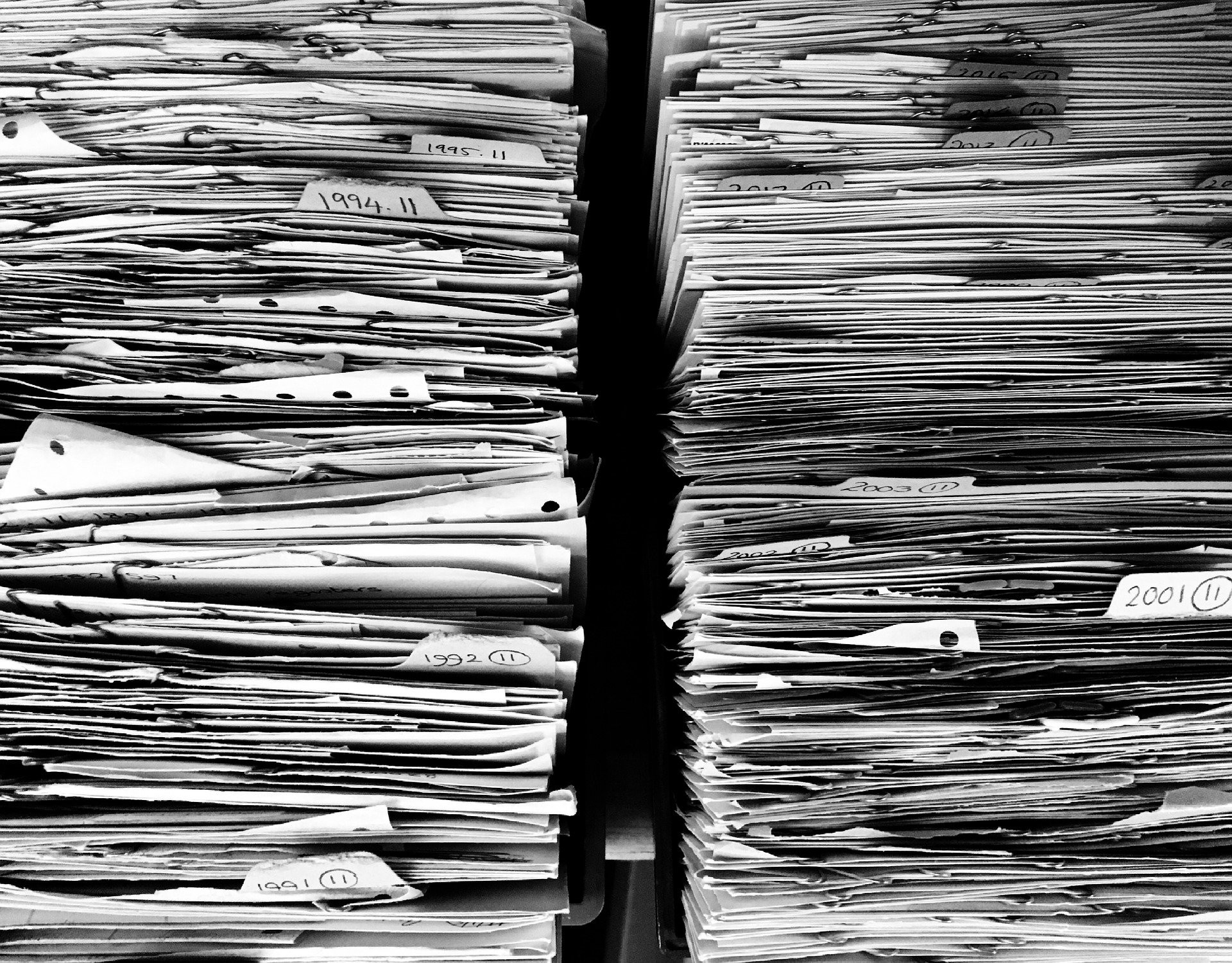 Two very large stacks of paper. Image by Ag Ku from Pixabay